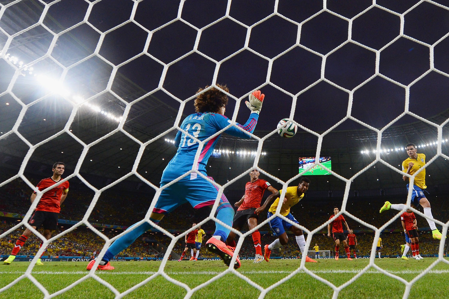 June 17, 2014 . Guillermo Ochoa of Mexico makes a save after a header by Thiago Silva of Brazil (R) during the 2014 FIFA World Cup Brazil Group A match between Brazil and Mexico at Castelao on in Fortaleza, Brazil.