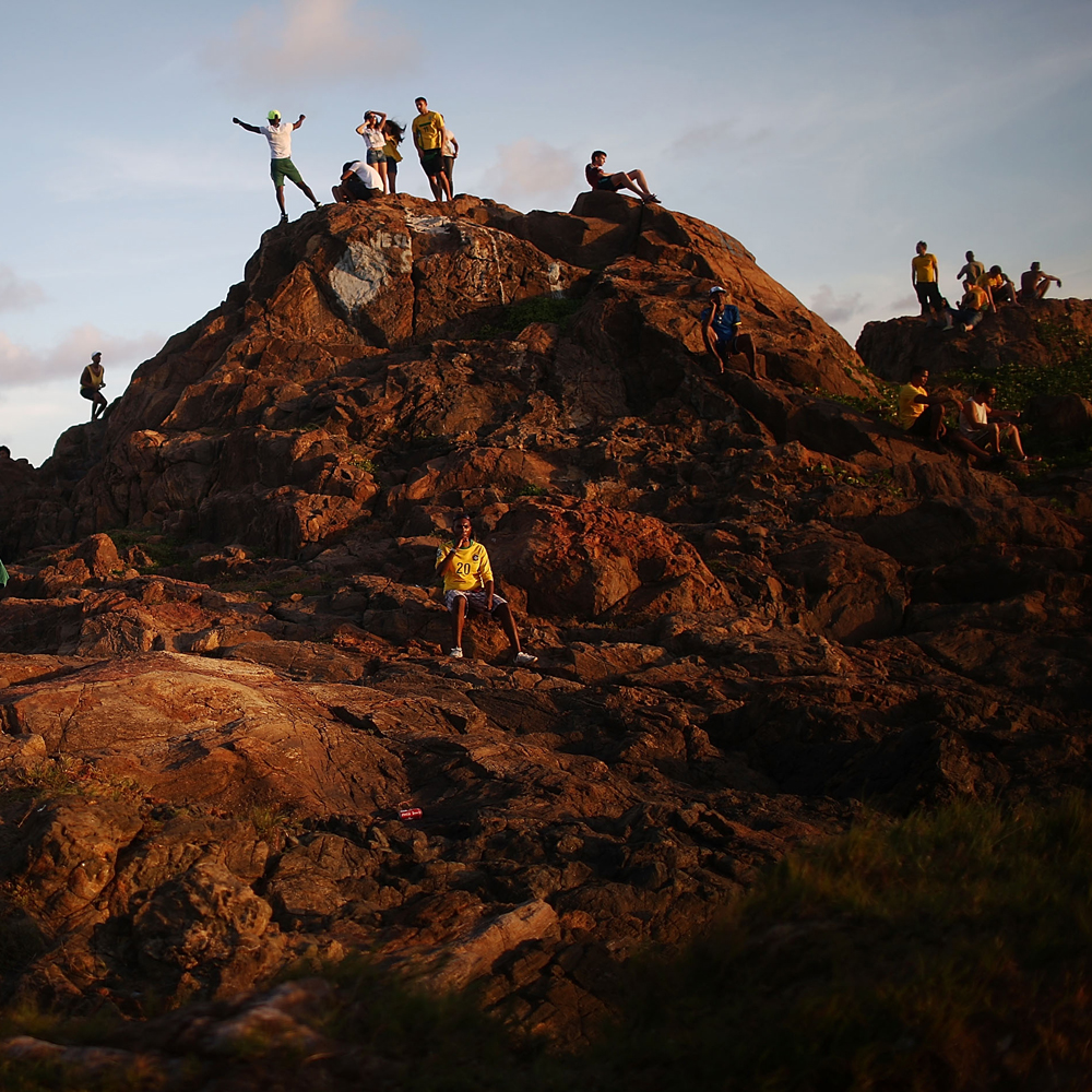 June 17, 2014. Fans gather on a hill at Farol da Barra during halftime at a Fan Fest for the Brazil-Mexico match in the 2014 FIFA World Cup on June 17, 2014 in Salvador, Brazil. Today is the sixth day of the World Cup and the second match for home team Brazil.