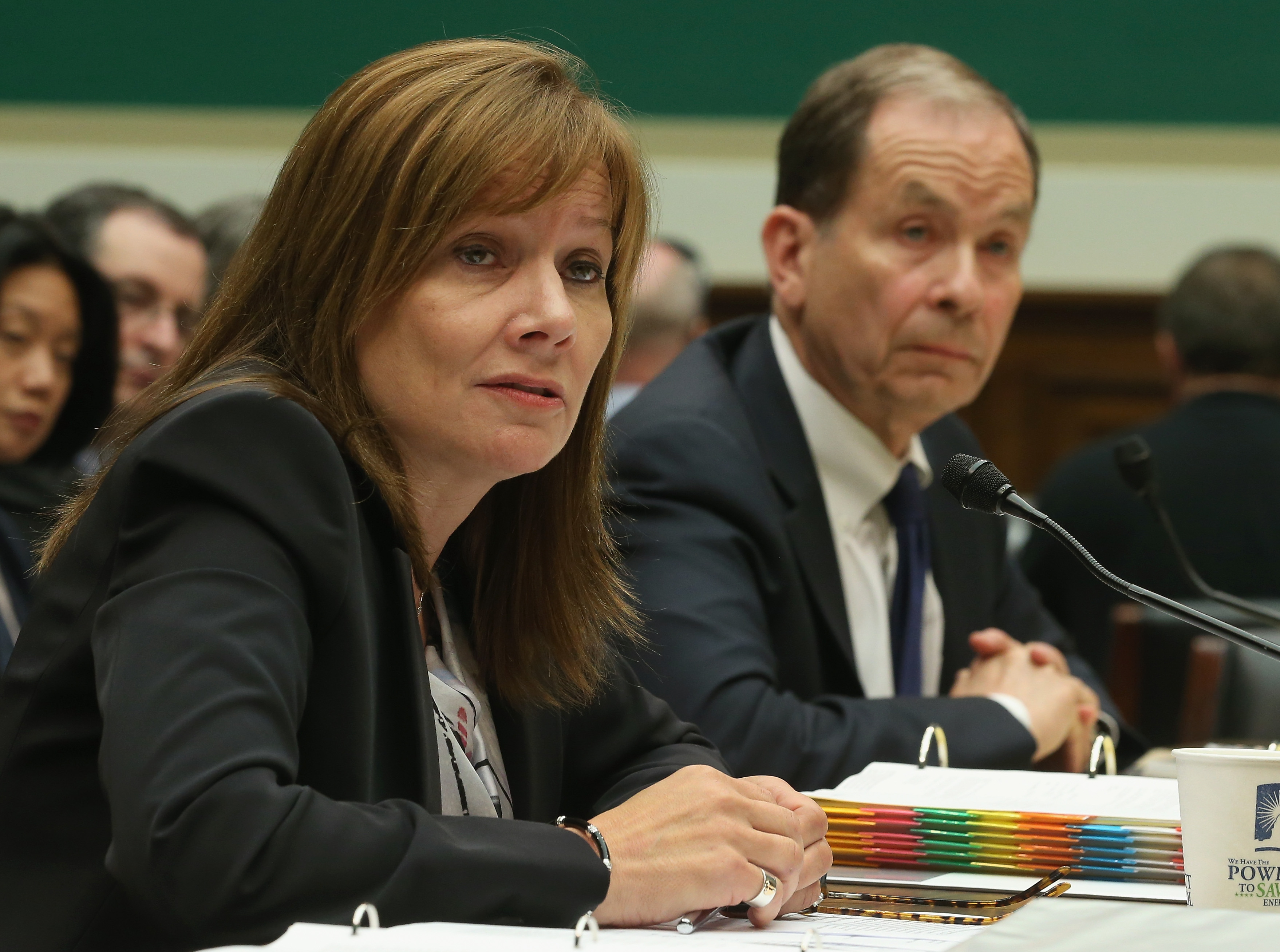 General Motors CEO Mary Barra (L), and Anton Valukas, head of GM's internal recall investigation, field questions while testifying during a House Energy and Commerce Committee hearing on Capitol Hill on June 18, 2014 in Washington, DC.