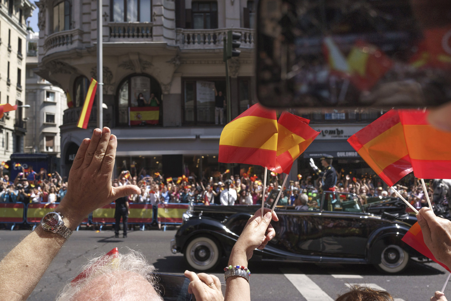 Jun. 19, 2014. King Felipe VI of Spain wave to the crowds during the royal procession down the Gran Via in Madrid, Spain.