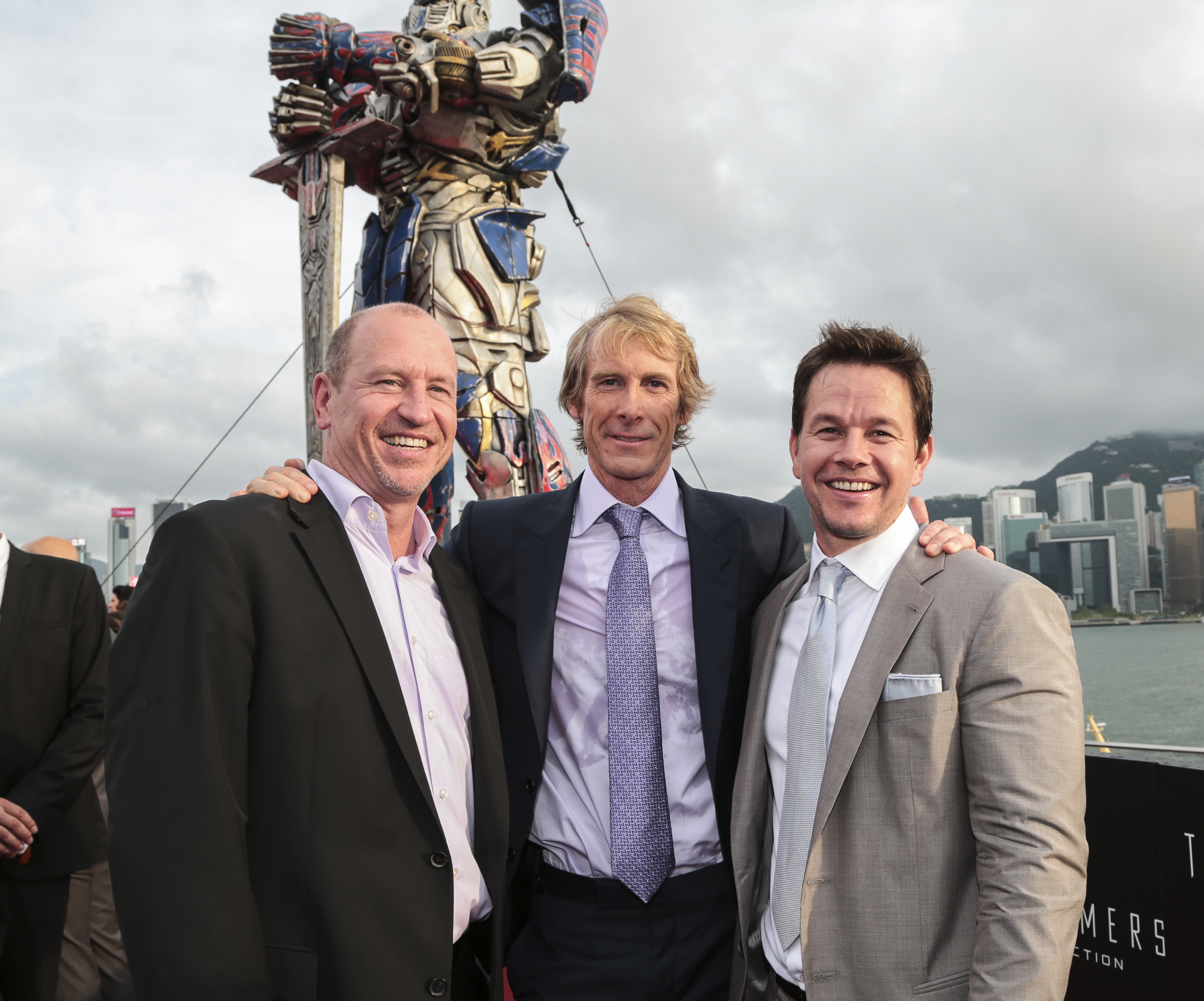 Rob Moore, Michael Bay and Mark Wahlberg arrive at the worldwide premiere screening of  Transformers: Age of Extinction at the  on June 19, 2014 in Hong Kong, Hong Kong.