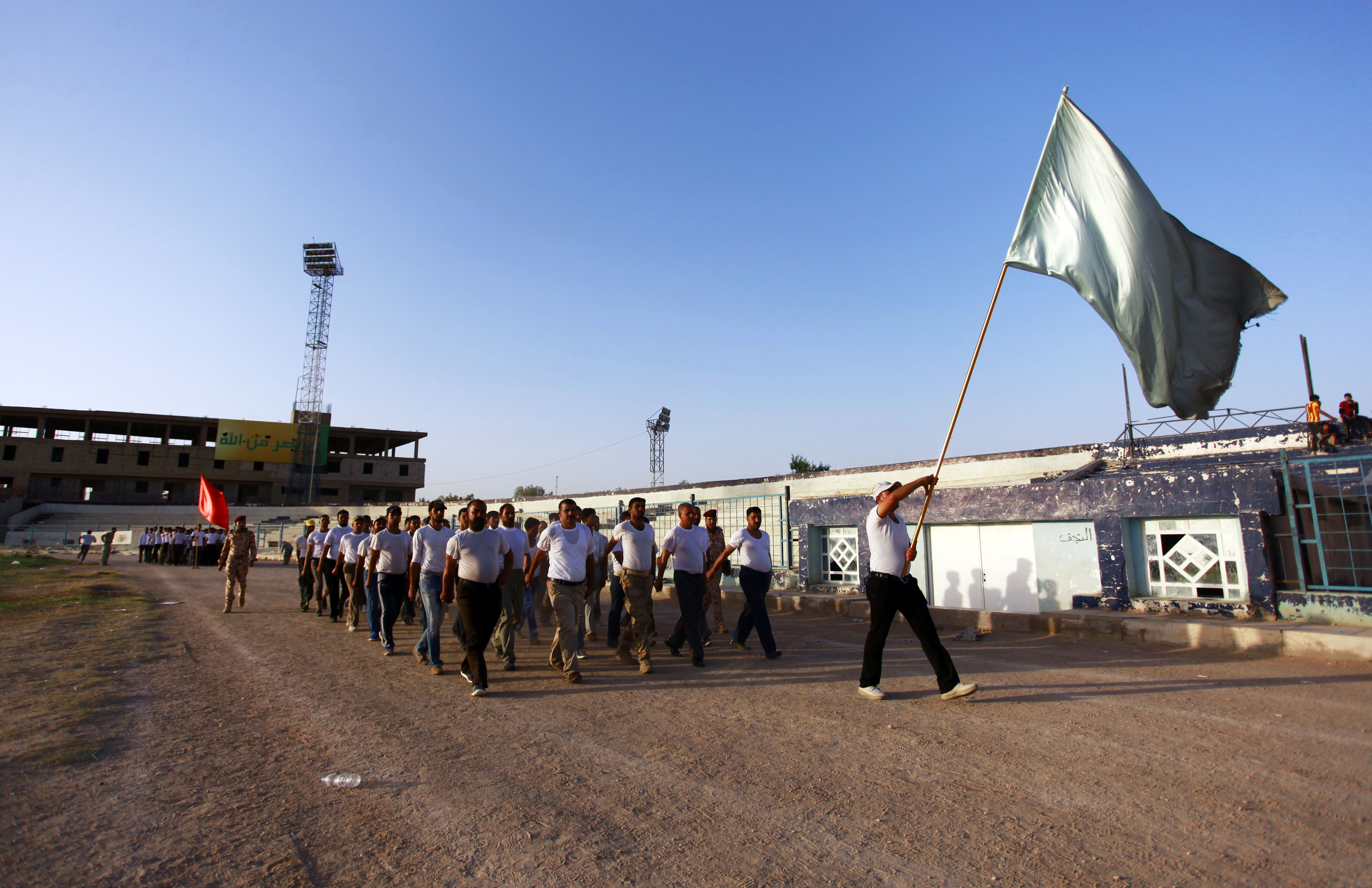 Shi'ite volunteers mobilize to fight in the central Iraqi city of Najaf on Sunday.