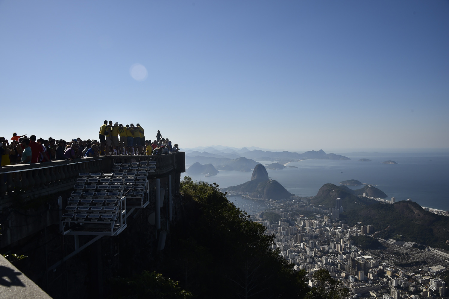 Jun. 24, 2014 Tourists visit the statue of Christ the Redeemer atop Corcovado hill in Rio de Janeiro  on the eve of a Group E football match between France and Ecuador during the 2014 FIFA World Cup.