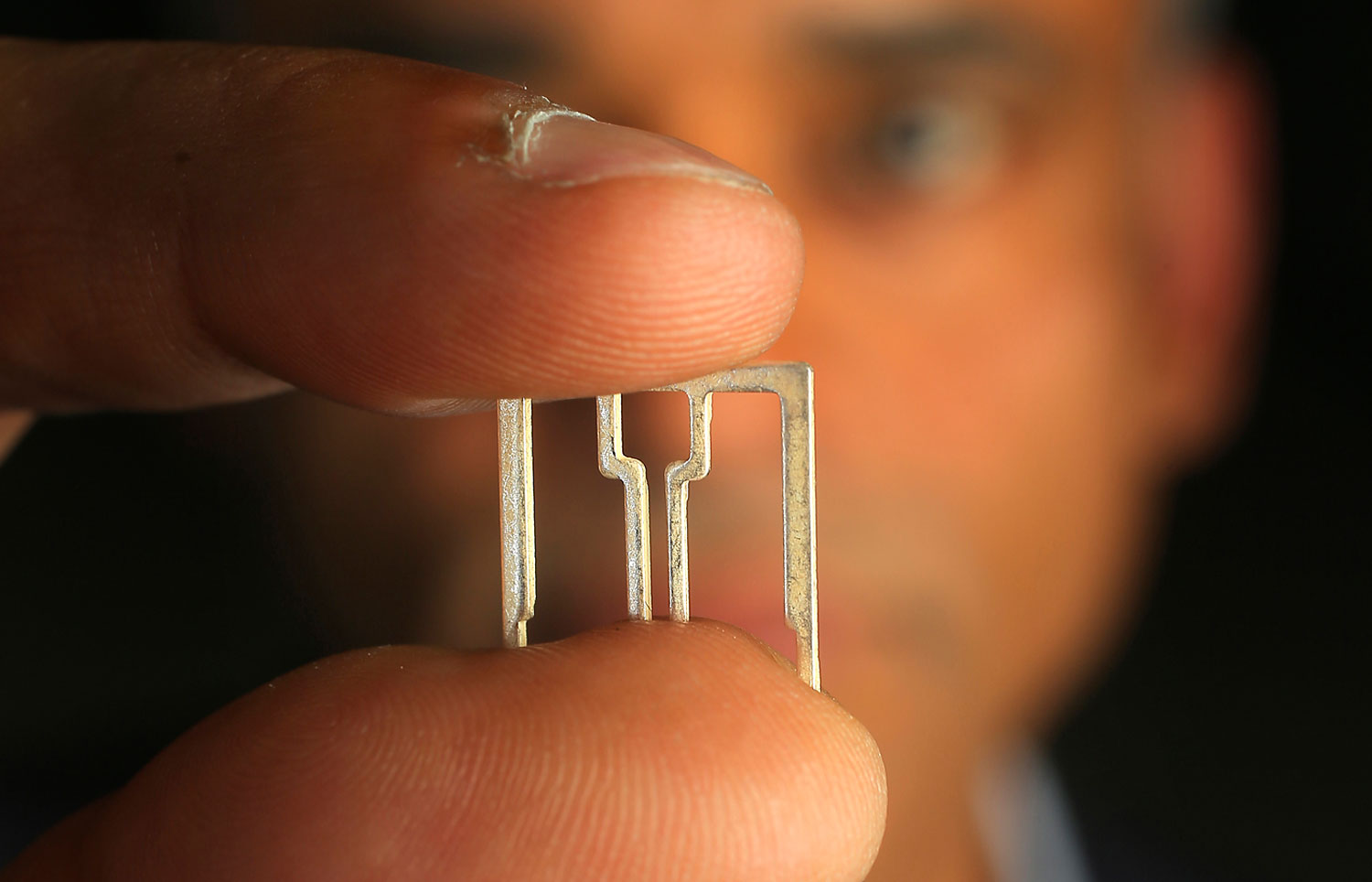 Aereo CEO Chet Kanojia holds one of the company's small antenna, May 22, 2014.