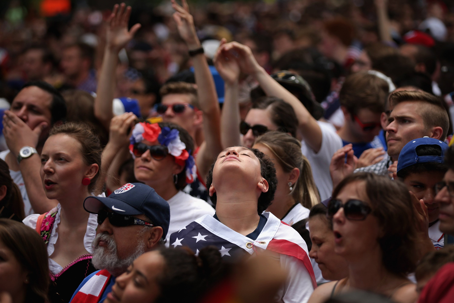 Jun. 26, 2014.  Thousands of soccer fans gather in Dupont Circle park to watch the US v Germany World Cup match  in Washington, United States. The German Embassy in the United States provided two large-screen televisions for fans of both teams to watch the last game of the 'Group of Death' match.