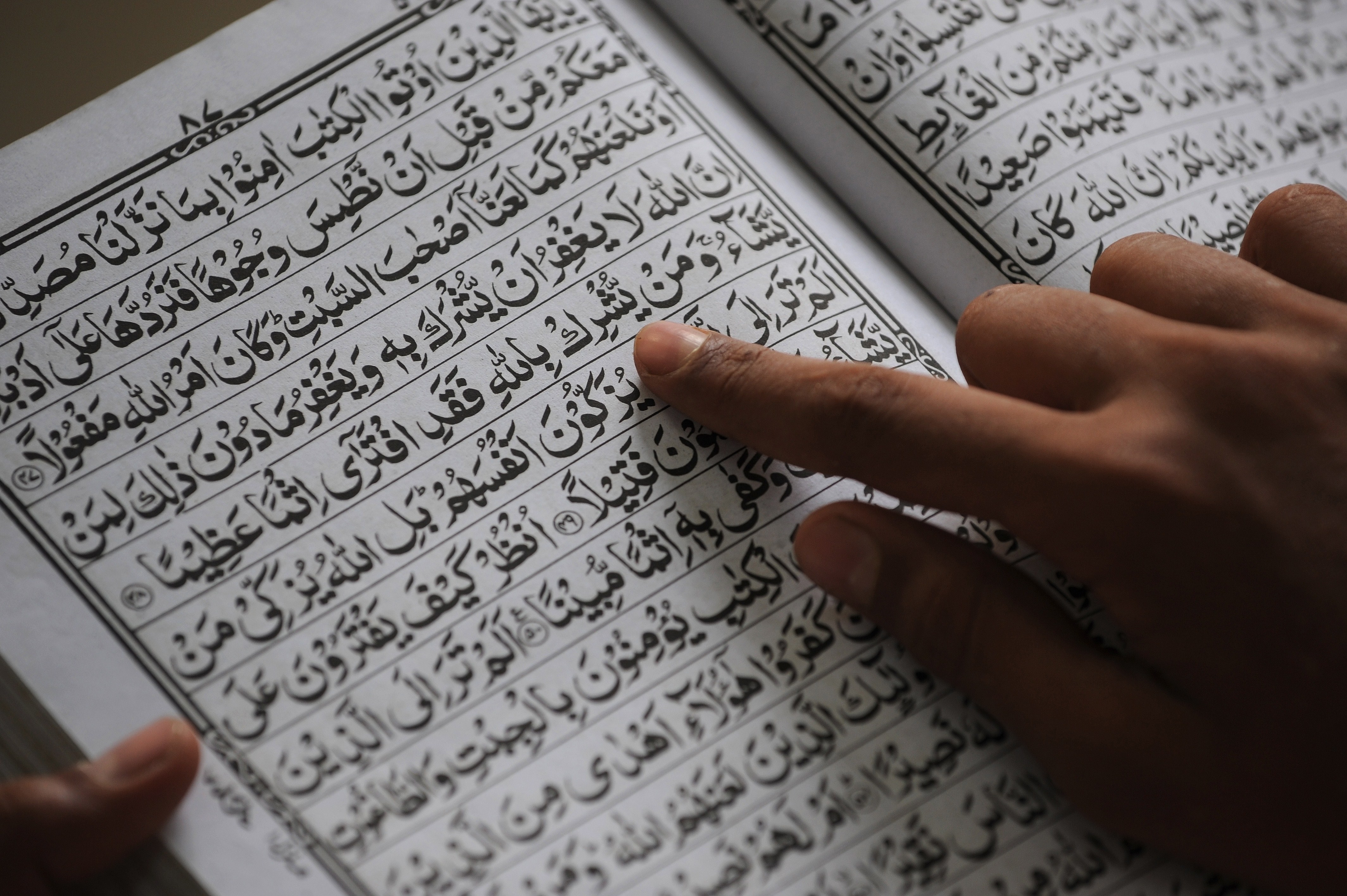 A Indian Muslim reads the Koran at a madrassa during the Islamic holy fasting month of Ramadan in Mumbai on June 30, 2014.
