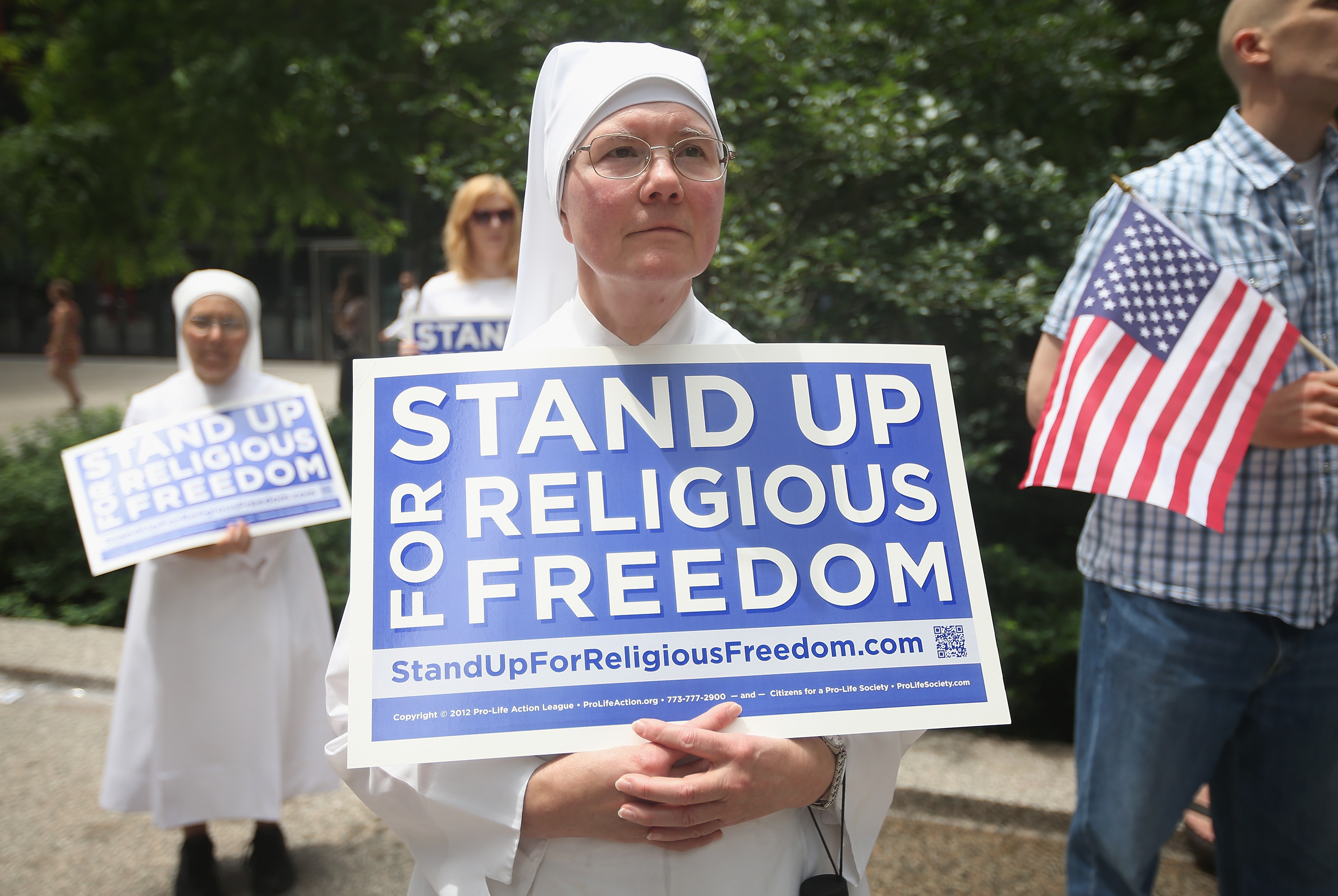 Sister Caroline attends a rally with other supporters of religious freedom to praise the Supreme Court's decision in the Hobby Lobby, contraception coverage requirement case on June 30, 2014 in Chicago, Illinois.