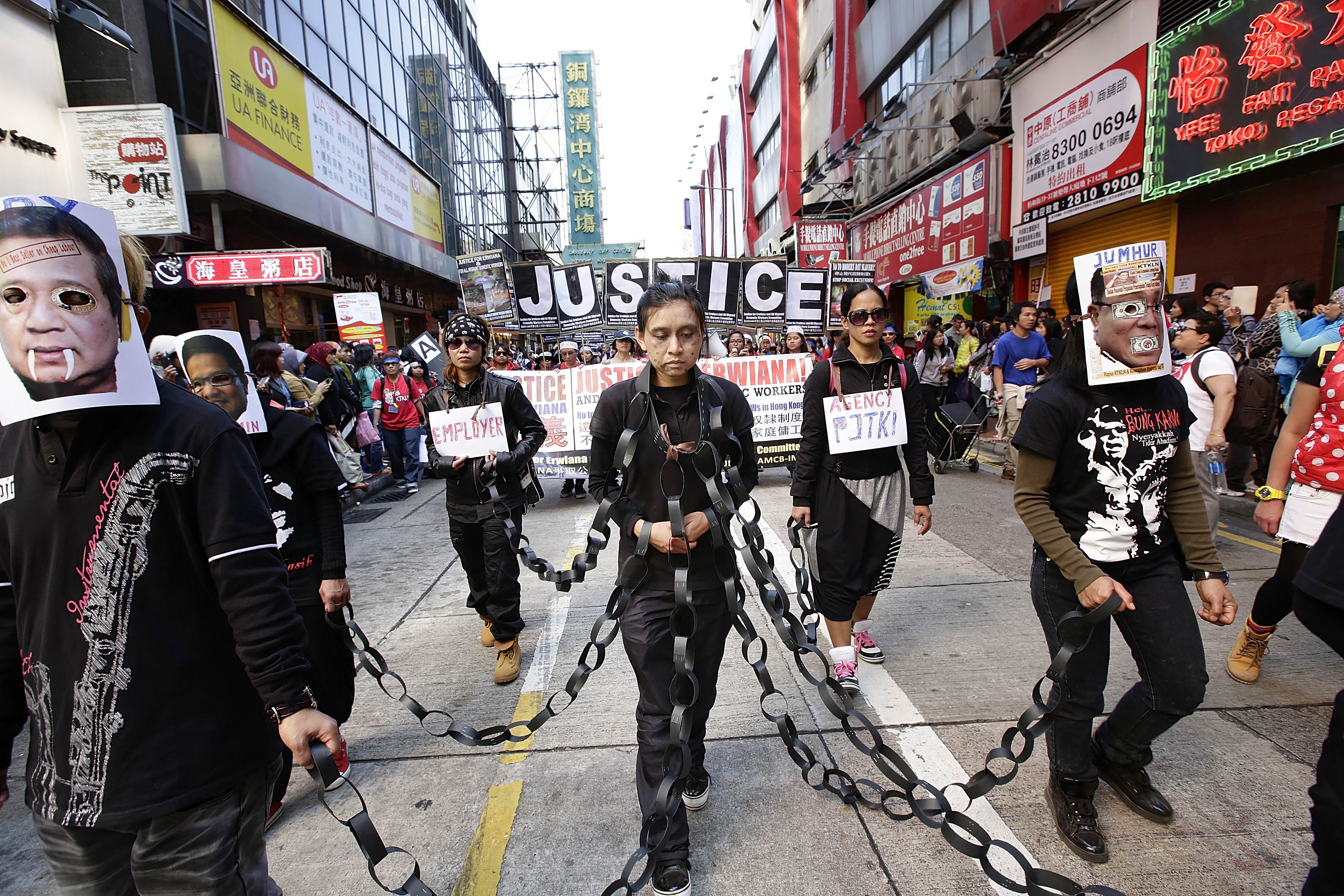 Indonesian domestic workers protest in the streets of Causeway Bay to demand better working conditions in Hong Kong on Jan. 26, 2014