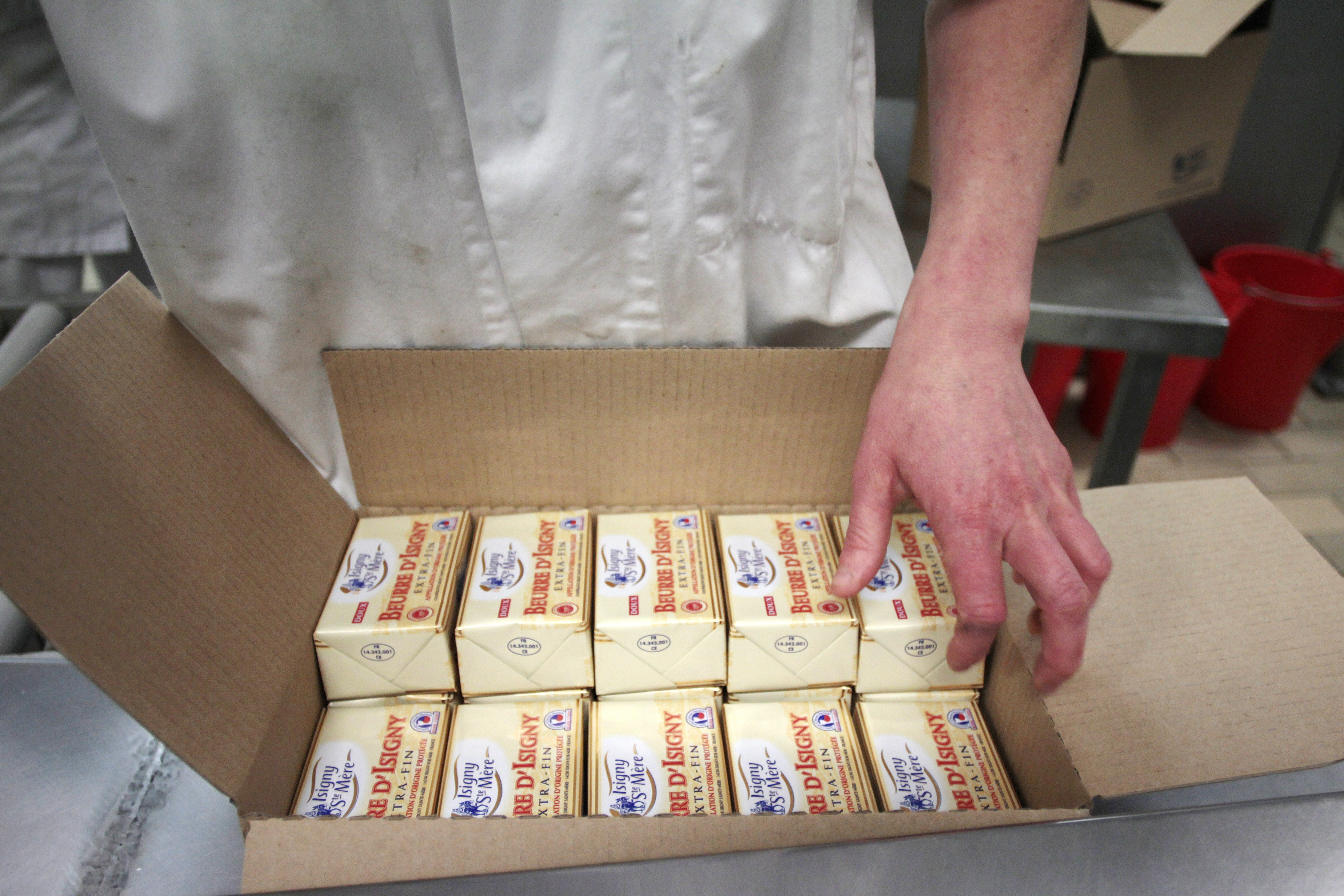 A worker packs butter at the production site of the Isigny-Sainte-Mere dairy co-operative in Isigny-sur-Mer, northwestern France, on April 4, 2014.