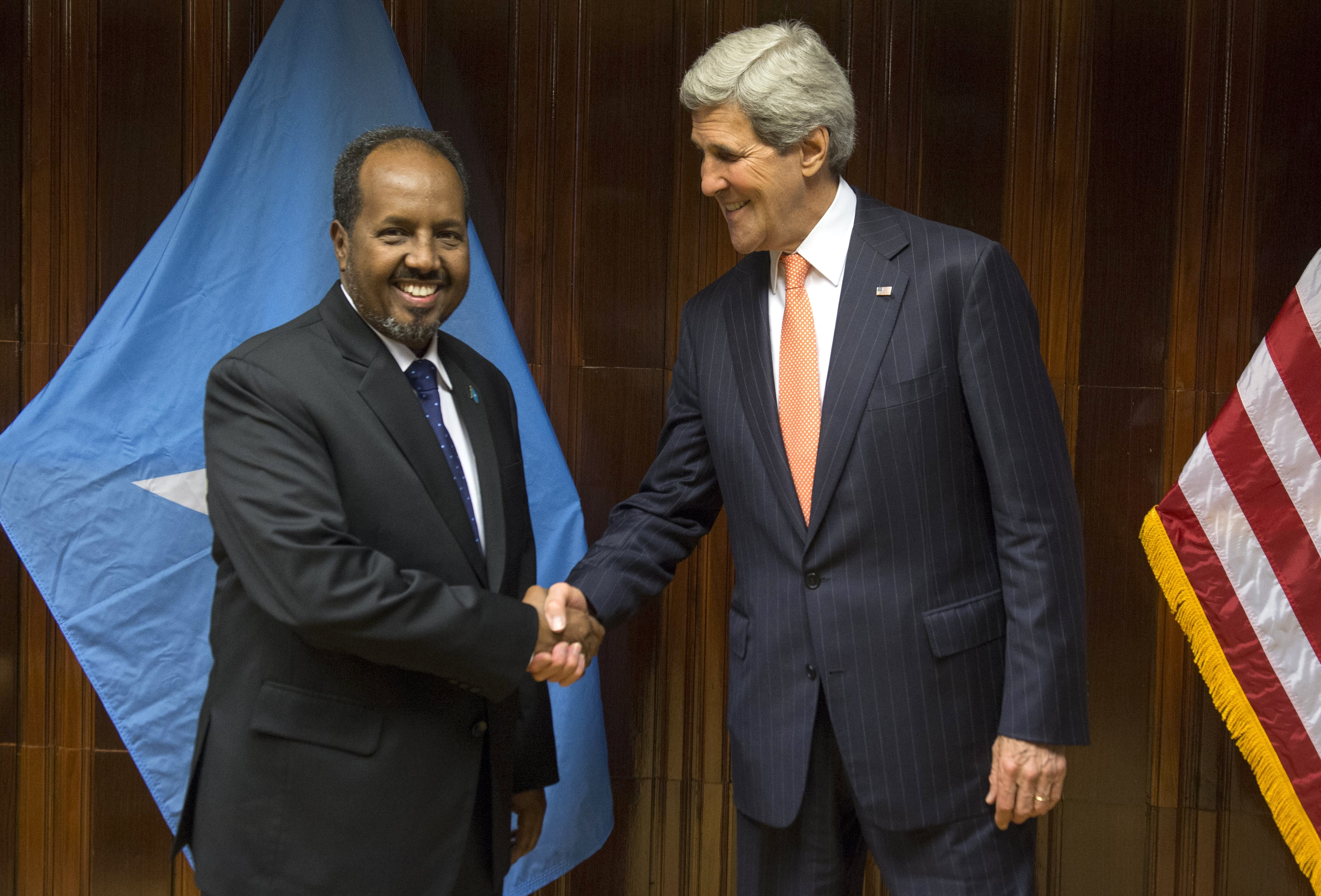 US Secretary of State John Kerry (R) and Somali President Hassan Sheikh Mohamud shake hands prior to a meeting at Addis Ababa Bole International Airport on May 3, 2014.