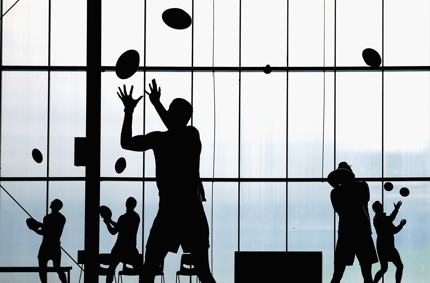Players from the Melbourne Kangaroos practice their ball skills during a training session  in Melbourne on June 3, 2014.