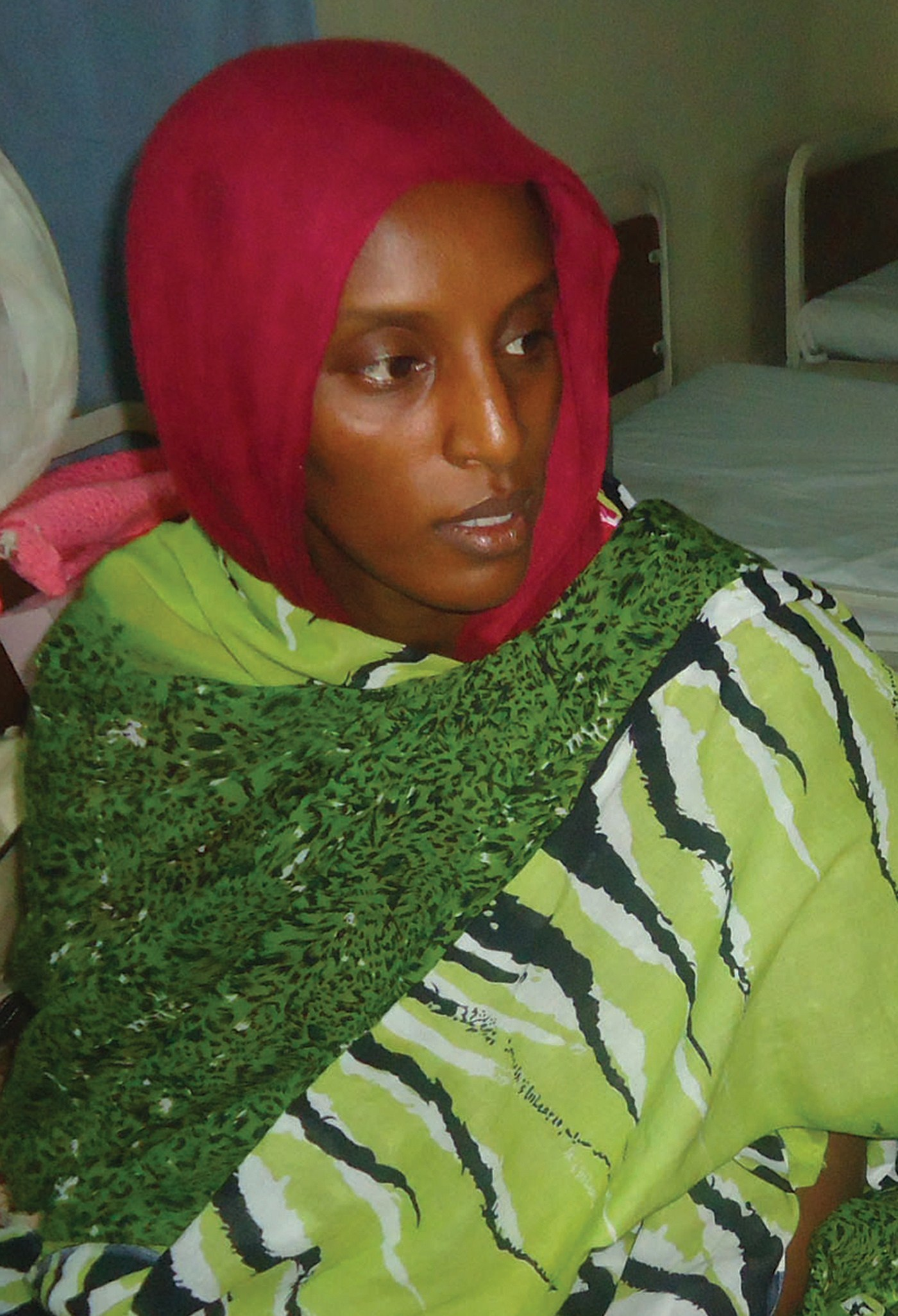 Meriam Yahia Ibrahim Ishag, a 27-year-old Christian Sudanese woman sentenced to hang for apostasy, sits in her cell a day after she gave birth to a baby girl at a women's prison in Khartoum's twin city of Omdurman