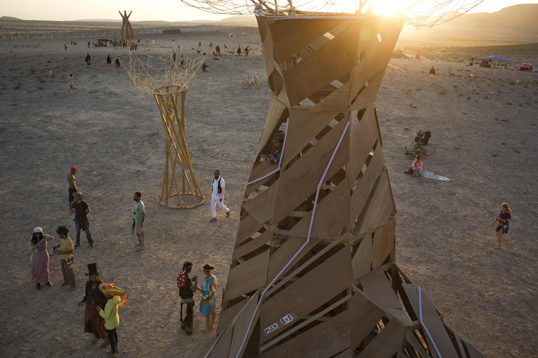 People, mostly Israelis, walk in the playa                               at Israel''s first Midburn festival in the Negev Desert, Israel on June 6, 2014.