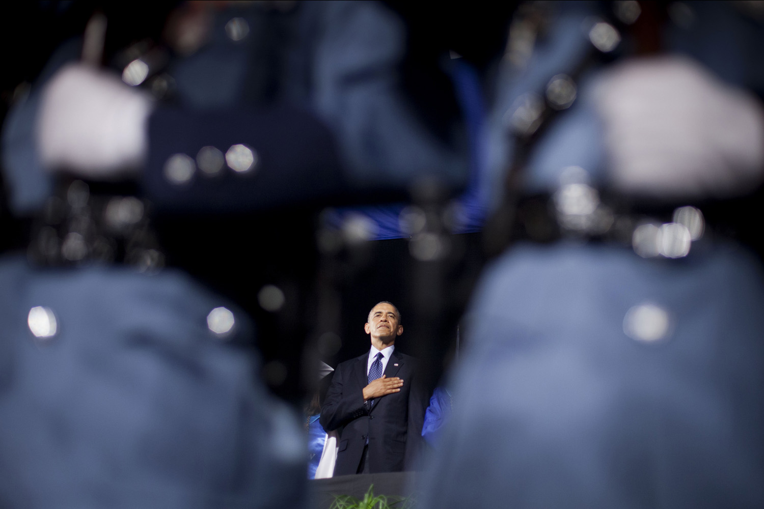 Jun. 11, 2014. President Barack Obama places his hand over his chest during the playing of the National Anthem prior to delivering the commencement address at Worcester Technical High School in Worcester, Mass.