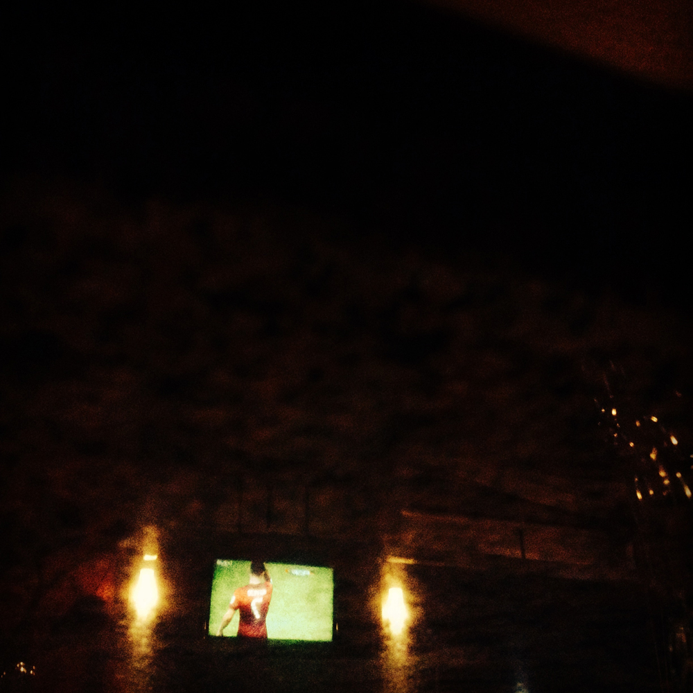June 16, 2014. Portugal's Cristiano Ronaldo is reflected off a TV screen in a Cairo cafe at the end of his team's somber 4-0 defeat against Germany in Portugal's first appearance in the 2014 FIFA World Cup being hosted in Brazil.