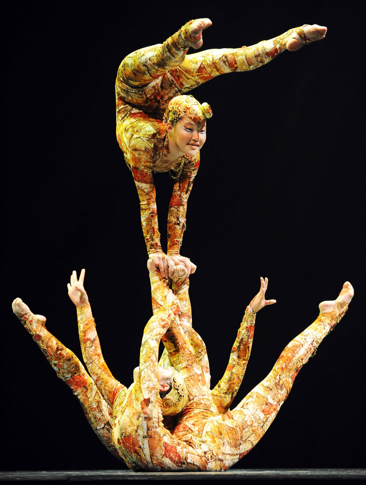Cirque Du Soleil performers contort their bodies during the  Kooza  press preview in Tokyo, on February 1, 2011.