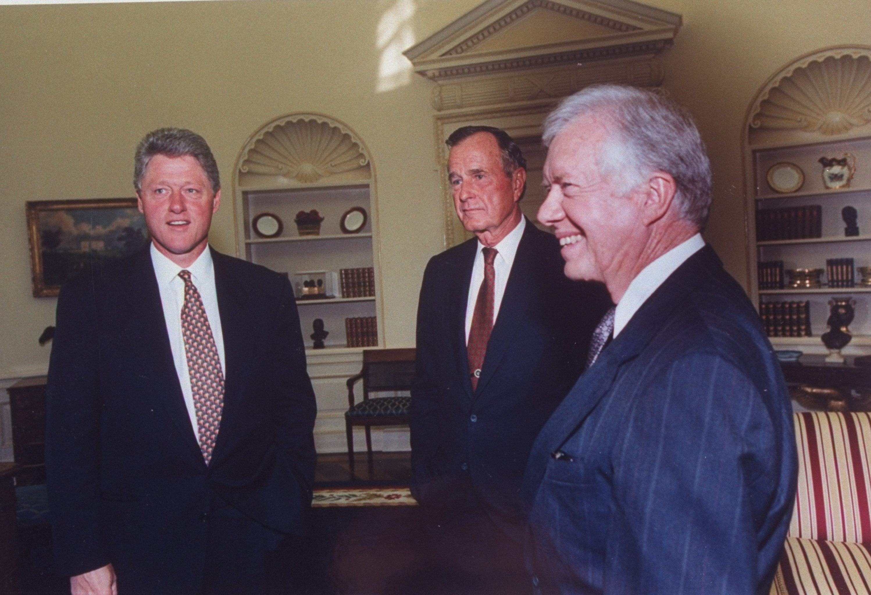 Pres. Bill Clinton (L) w. former Presidents Jimmy Carter (R) & George Bush in Oval Office, 2 being among invitees to the White House Israel/PLO peace accord signing ceremony.