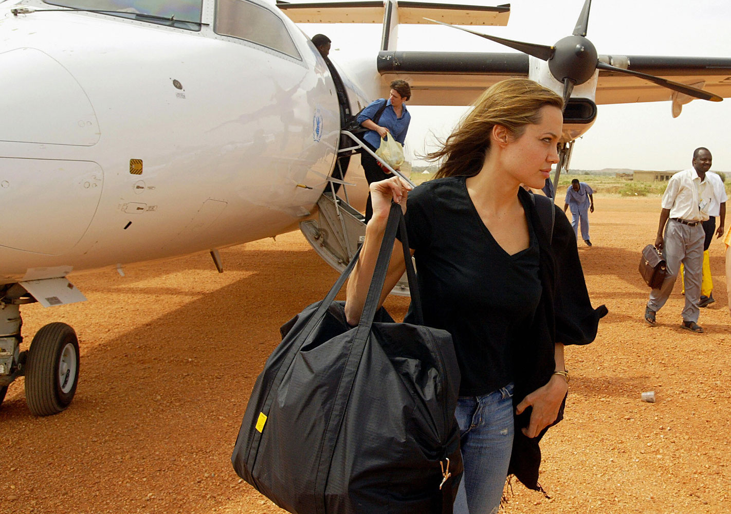 Angelina Jolie arrives at the El-Geneina airport in West Darfur as the Goodwill Ambassador for the United Nations High Commission for Refugees  on Oct. 25 2004.