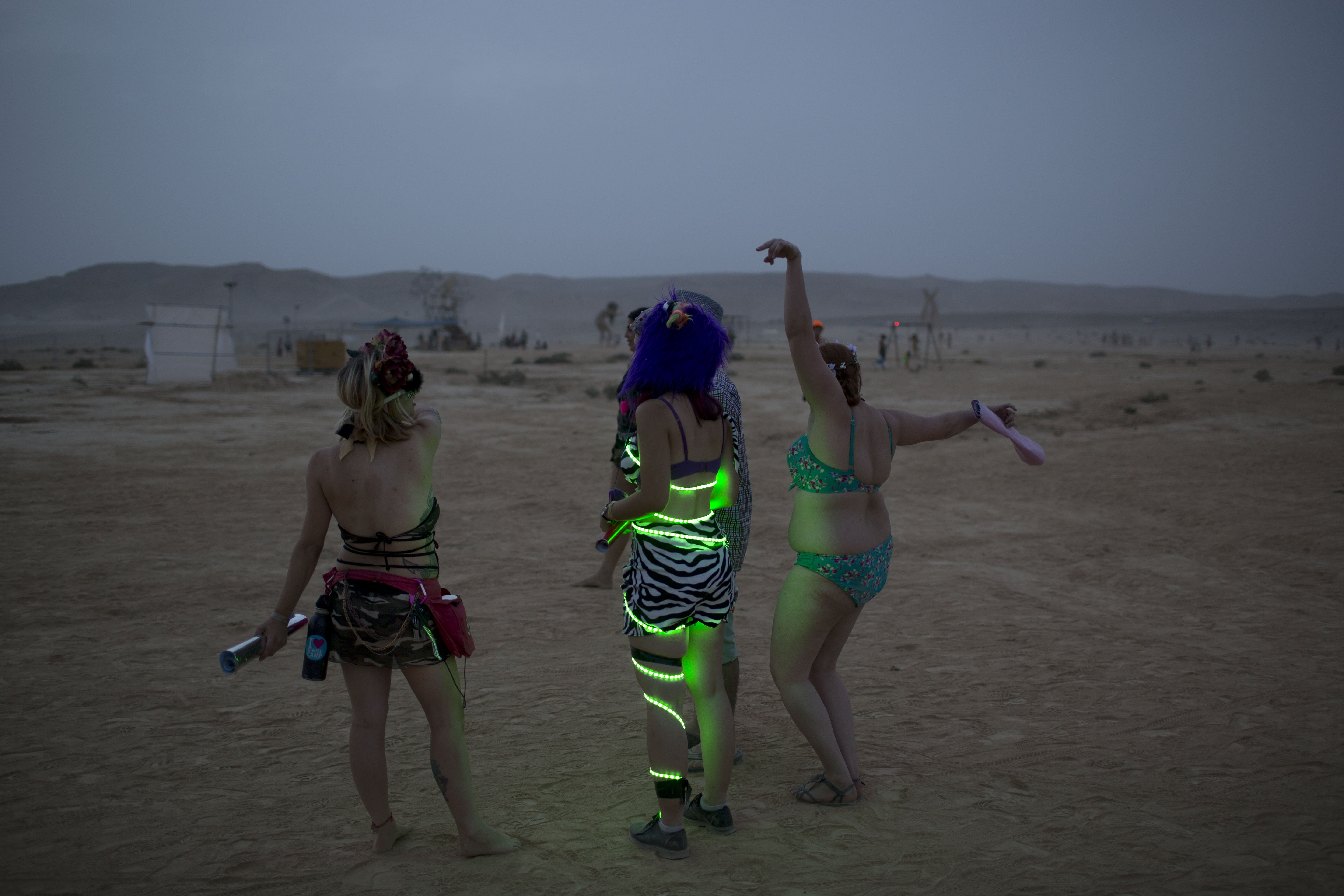 Israelis dance at a party in the Negev Desert, Israel on June 4, 2014.