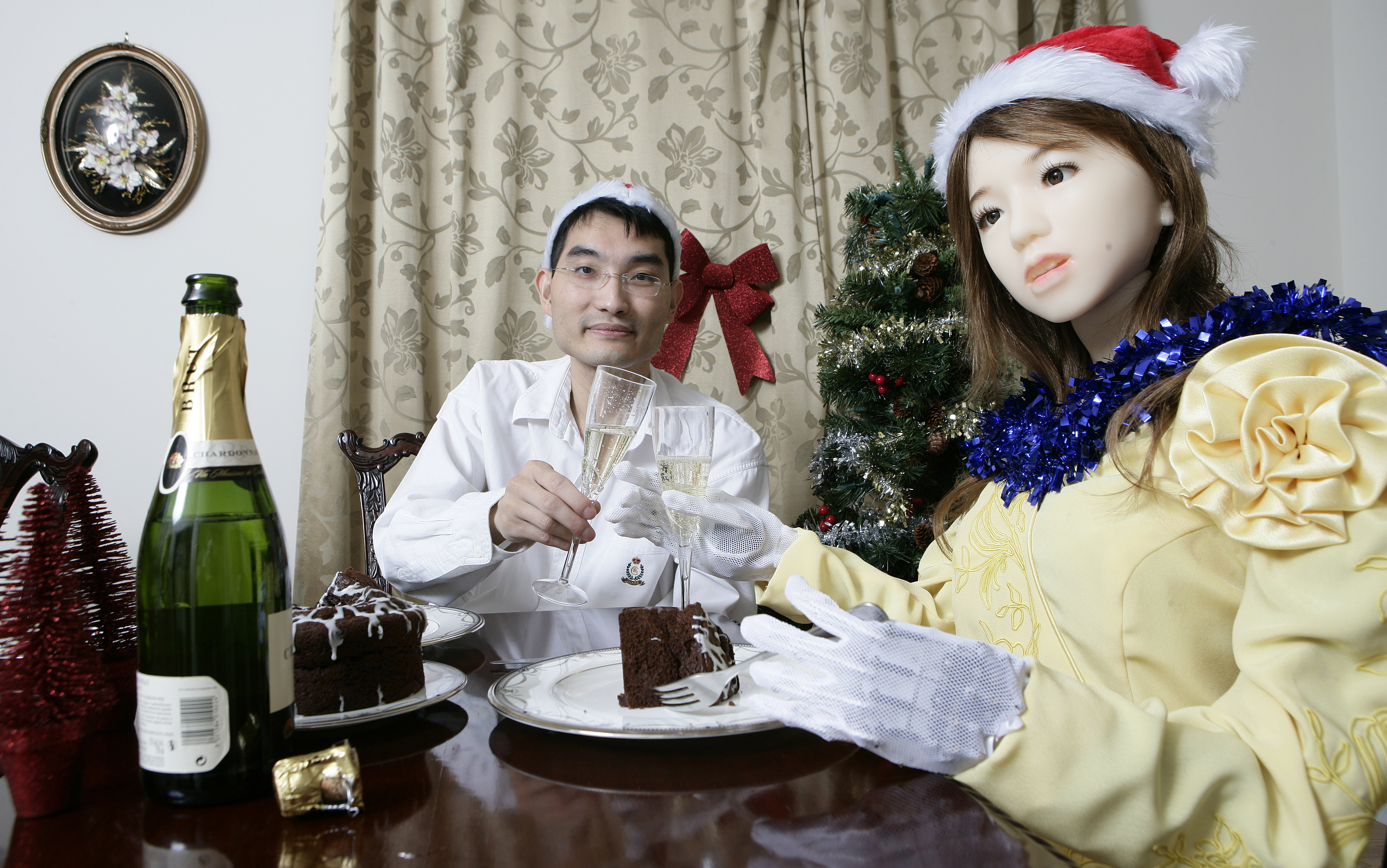 Inventor Le Trung celebrates Christmas with his robot Aiko on December 23, 2009 in Brampton, Ontario, Canada.