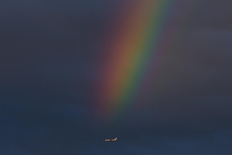 An Air China jet flies past a rainbow over Beijing, June 6, 2014.
