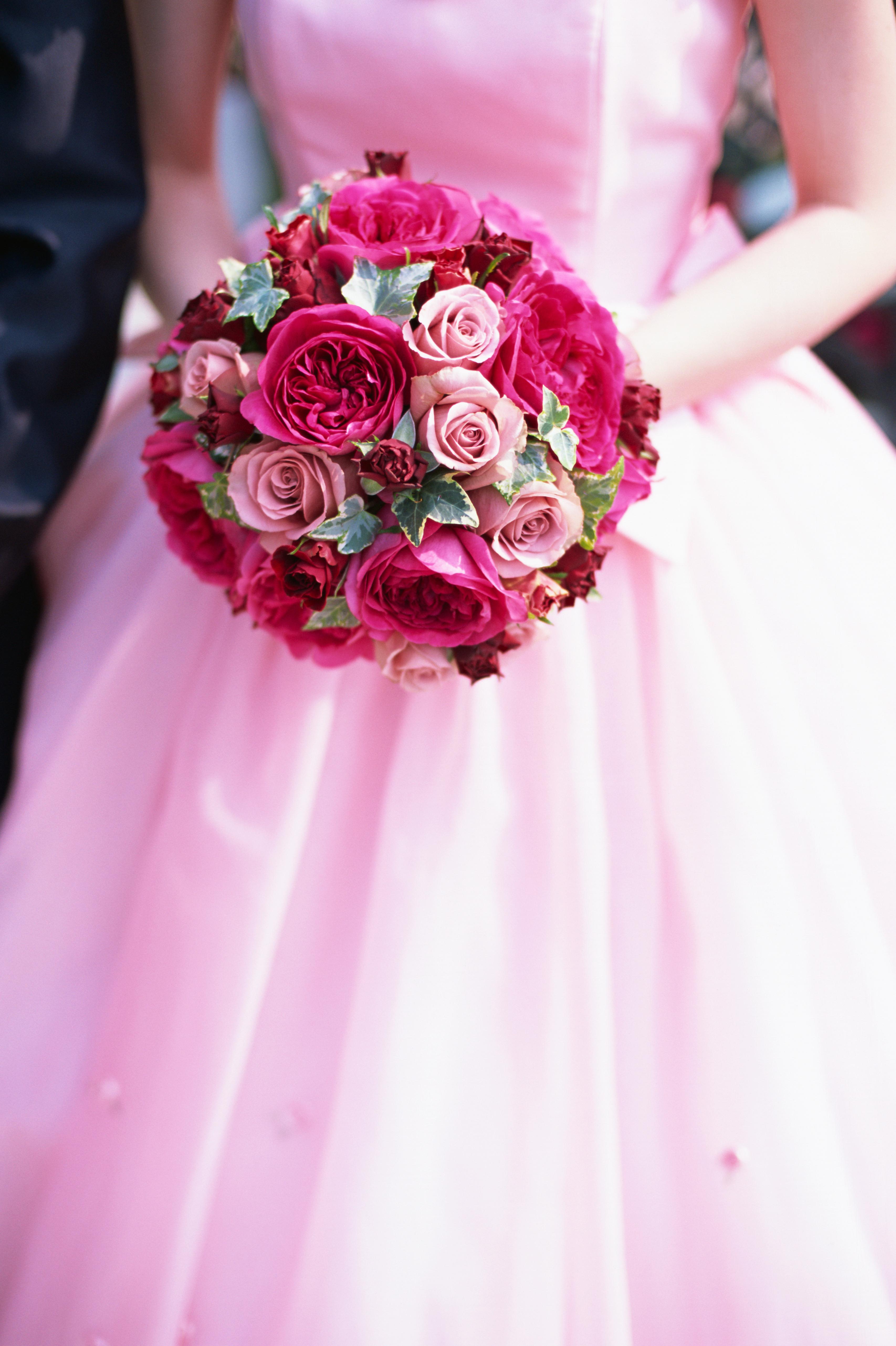 A pink bride holding a pink bouquet