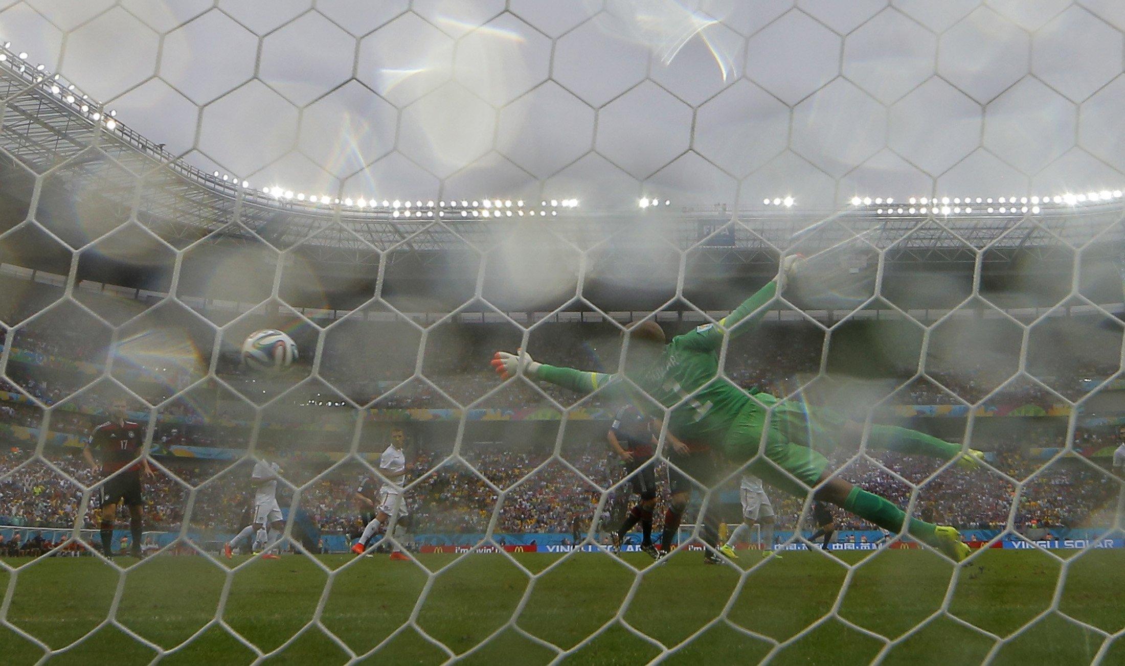 Germany's Thomas Mueller scores past goalkeeper Tim Howard of the U.S. at the Pernambuco arena in Recife June 26, 2014.