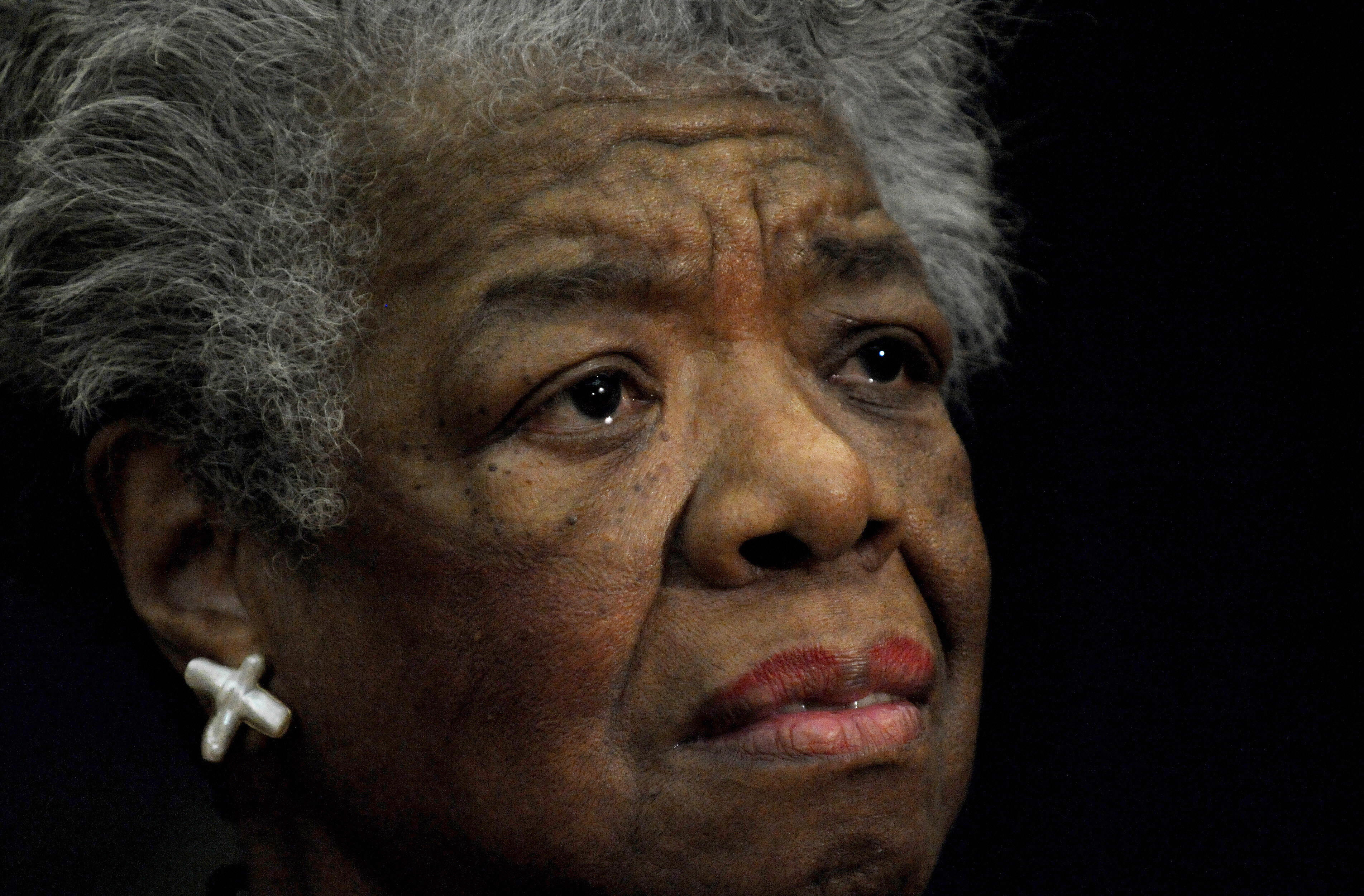 U.S. poet Maya Angelou reads a poem during a ceremony to present South African Archbishop Desmond Tutu of Cape Town the William J. Fulbright Prize for International Understanding on November 21, 2008, at the State Department in Washington.