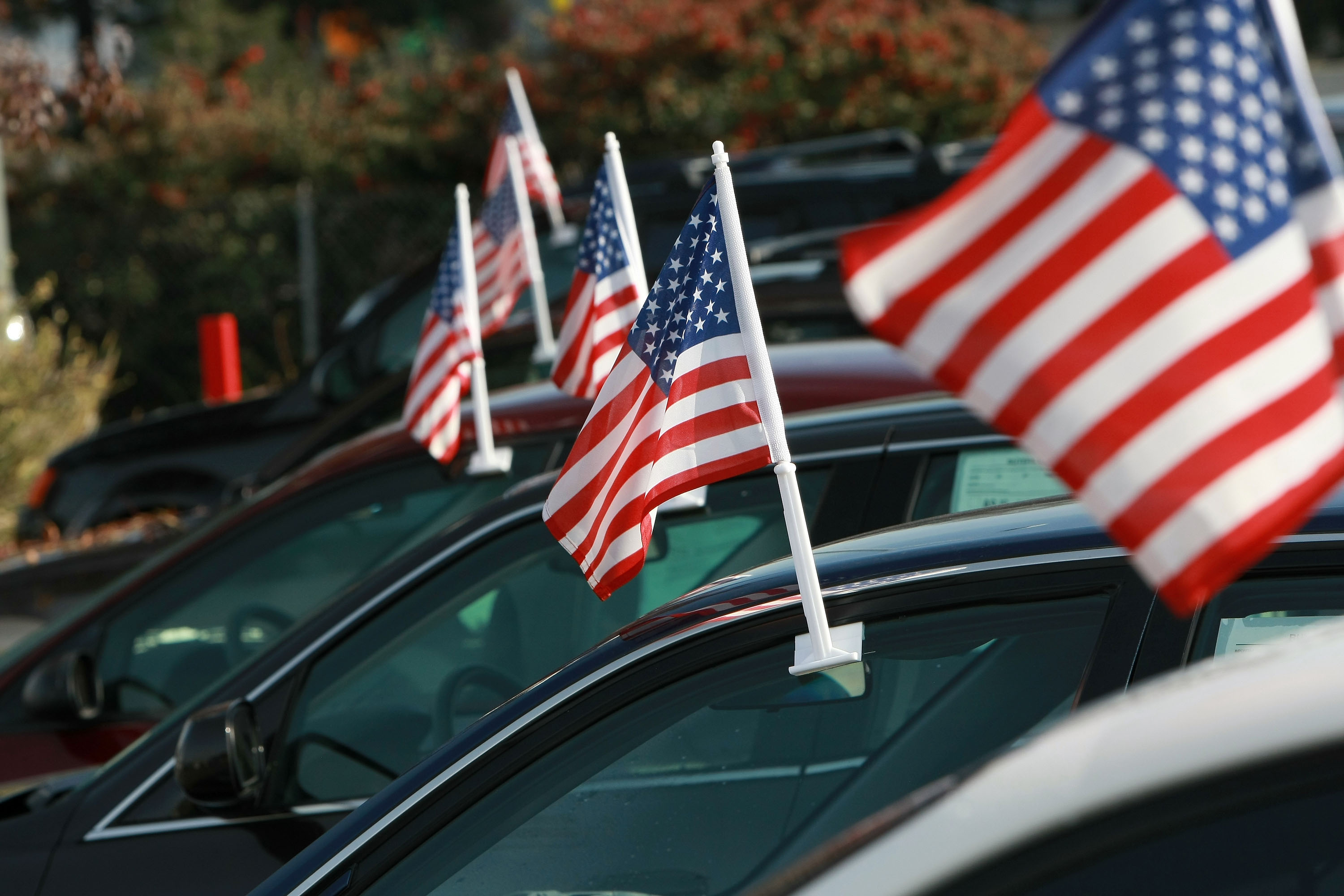 American flags are seen on cars for sale at Santa Rosa Chevrolet December 12, 2008 in Santa Rosa, California.