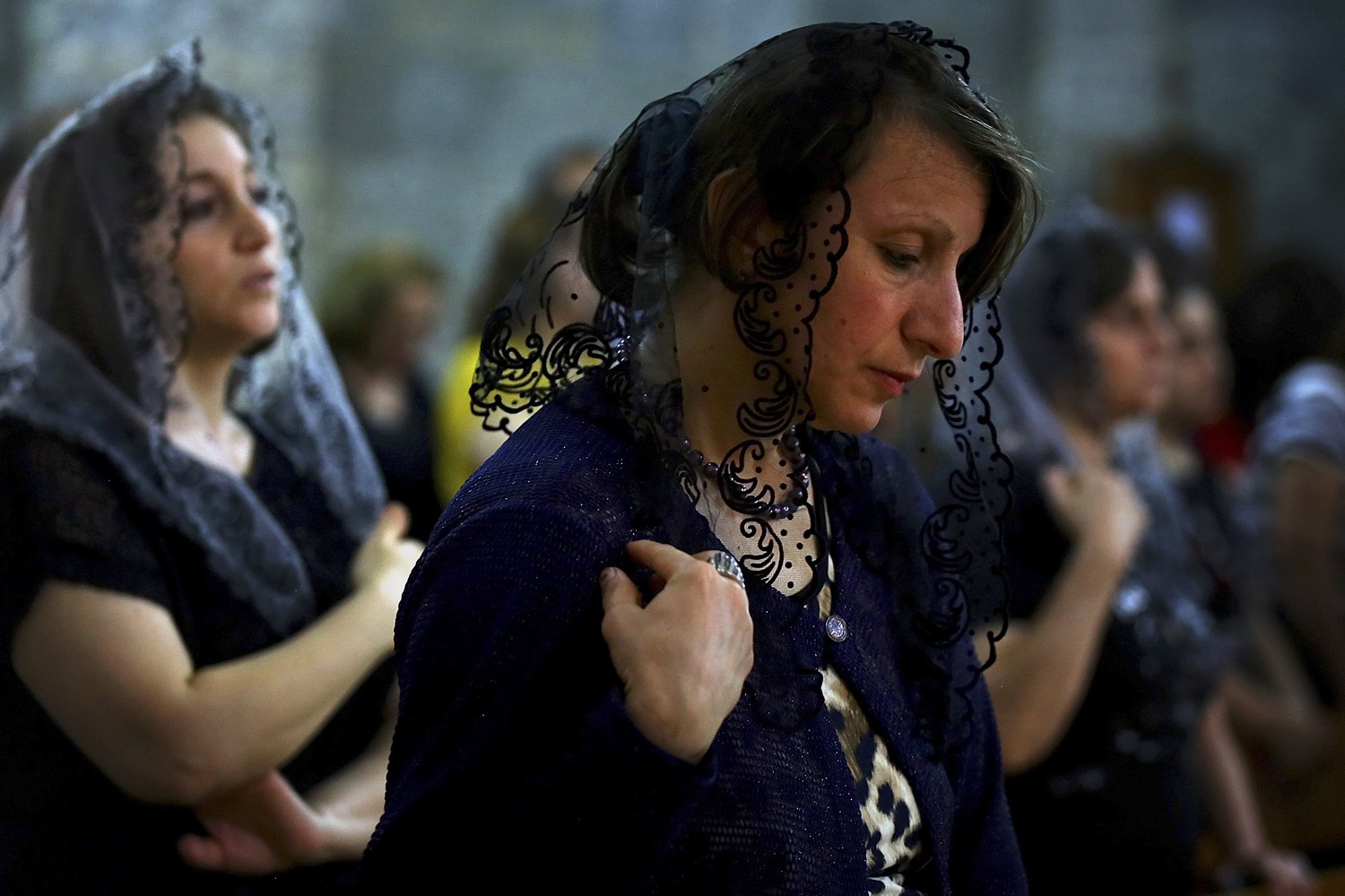 Jun. 15, 2014. Iraqis attend Mass at the Chaldean Church of the Virgin Mary of the Harvest, in Alqosh, set in the seventh century Saint Hormoz monastery built into a hill overlooking Alqosh, north of Mosul.