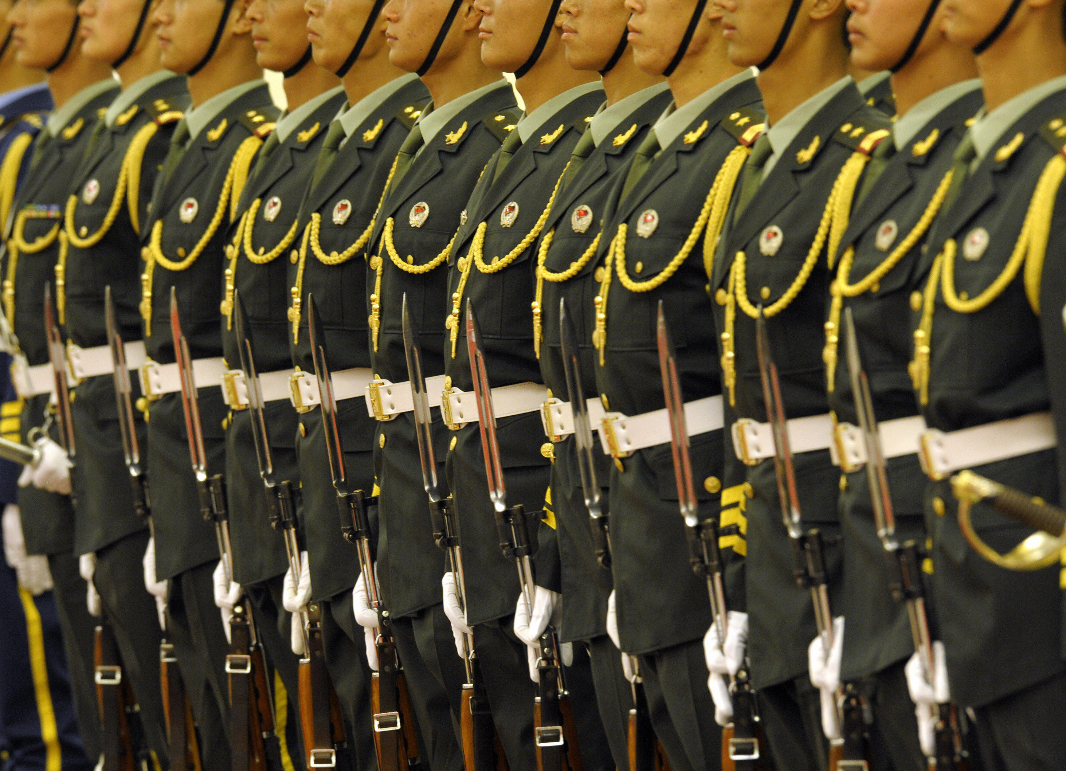 Chinese People's Liberation Army's honor guards line up during a welcome ceremony for Turkish President Abdullah Gul at the Great Hall of the People in Beijing on June 25, 2009.