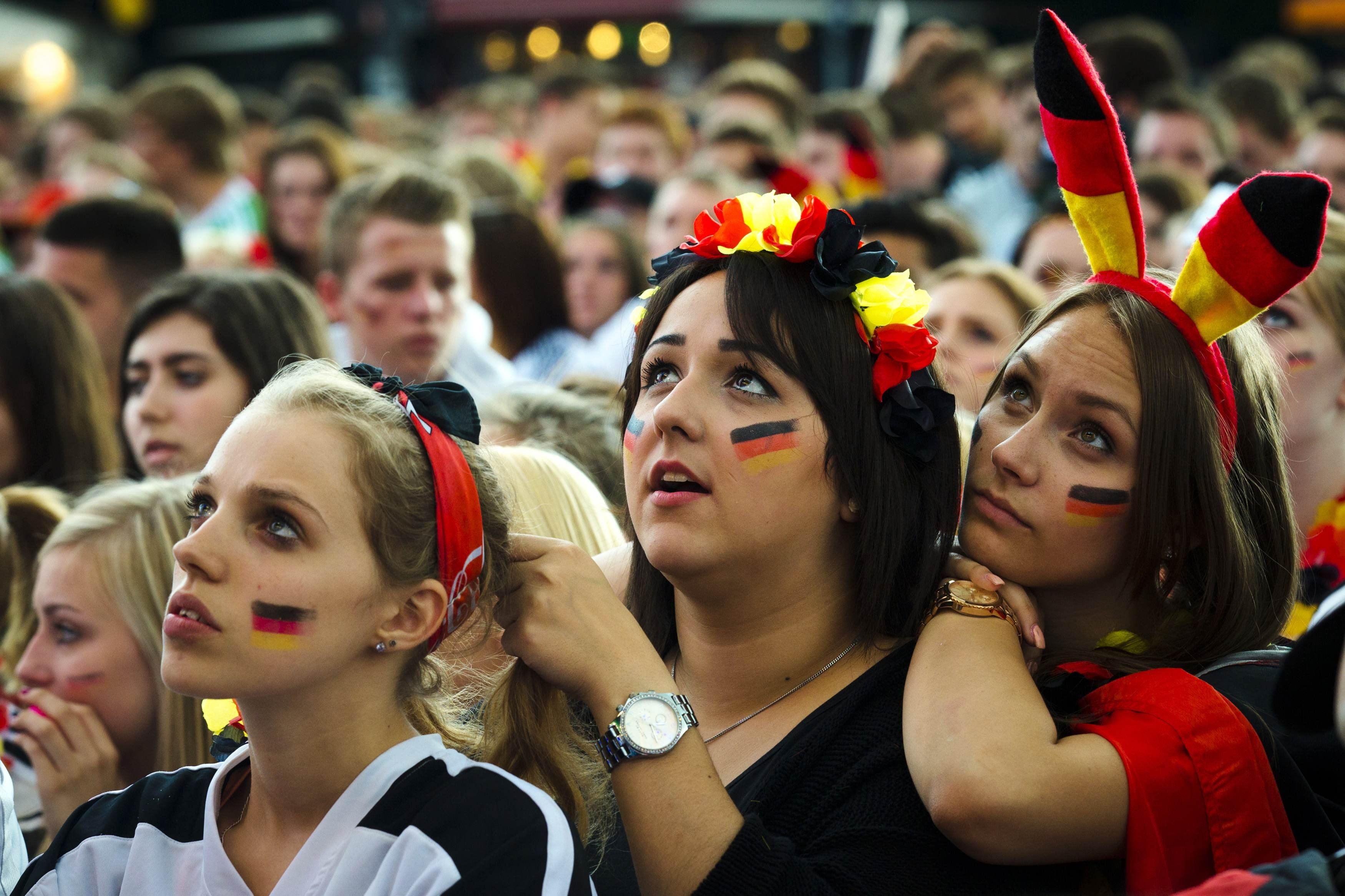 German fans watch as their team play against the U.S. at the Fanmeile public viewing arena in Berlin on June 26, 2014.