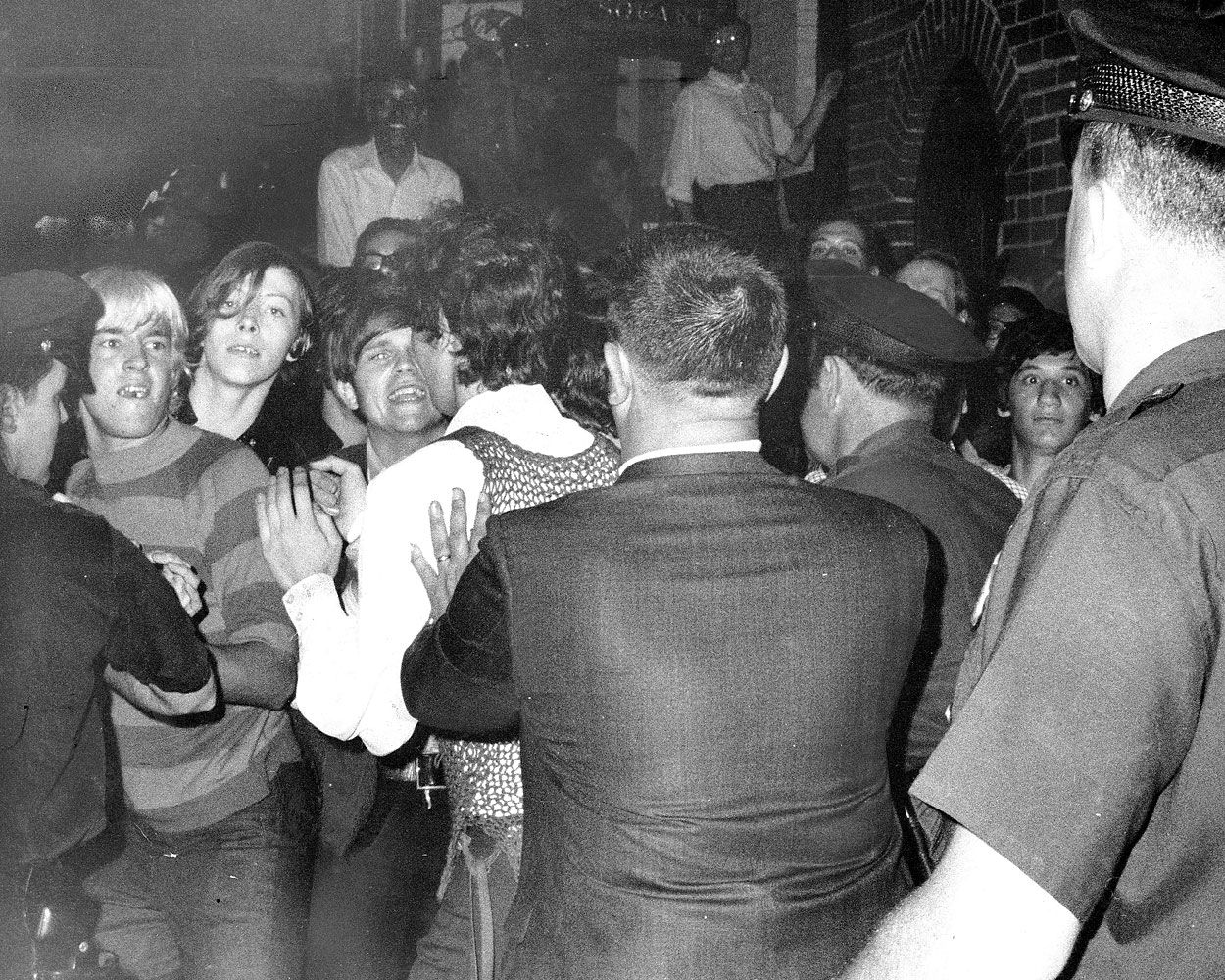 A crowd attempts to impede police arrests outside the Stonewall Inn in Greenwich Village, New York City, on June 28, 1969