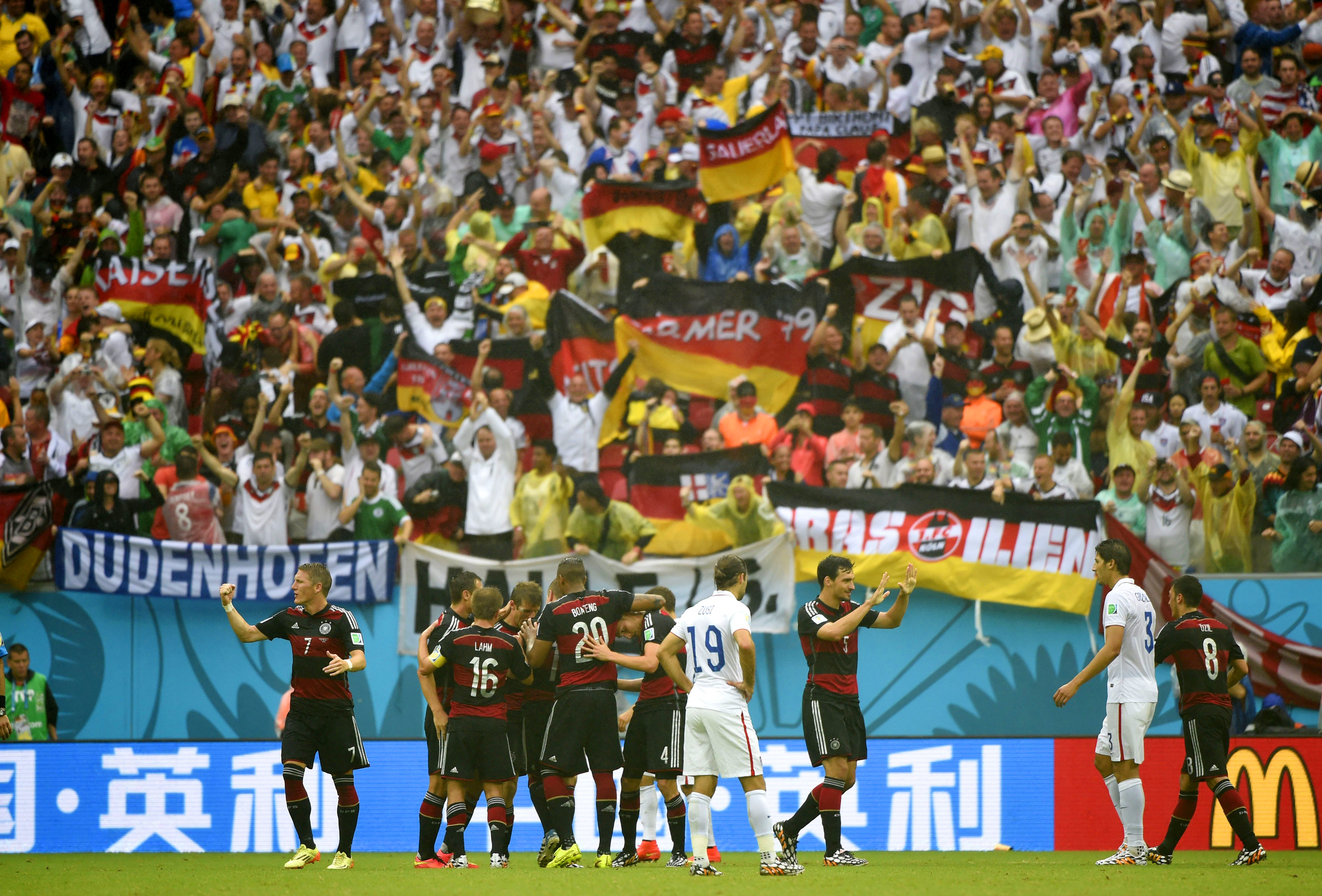 Germany's players celebrate for Thomas Muller's goal at the Arena Pernambuco Stadium in Recife, Brazil, on June 26, 2014.