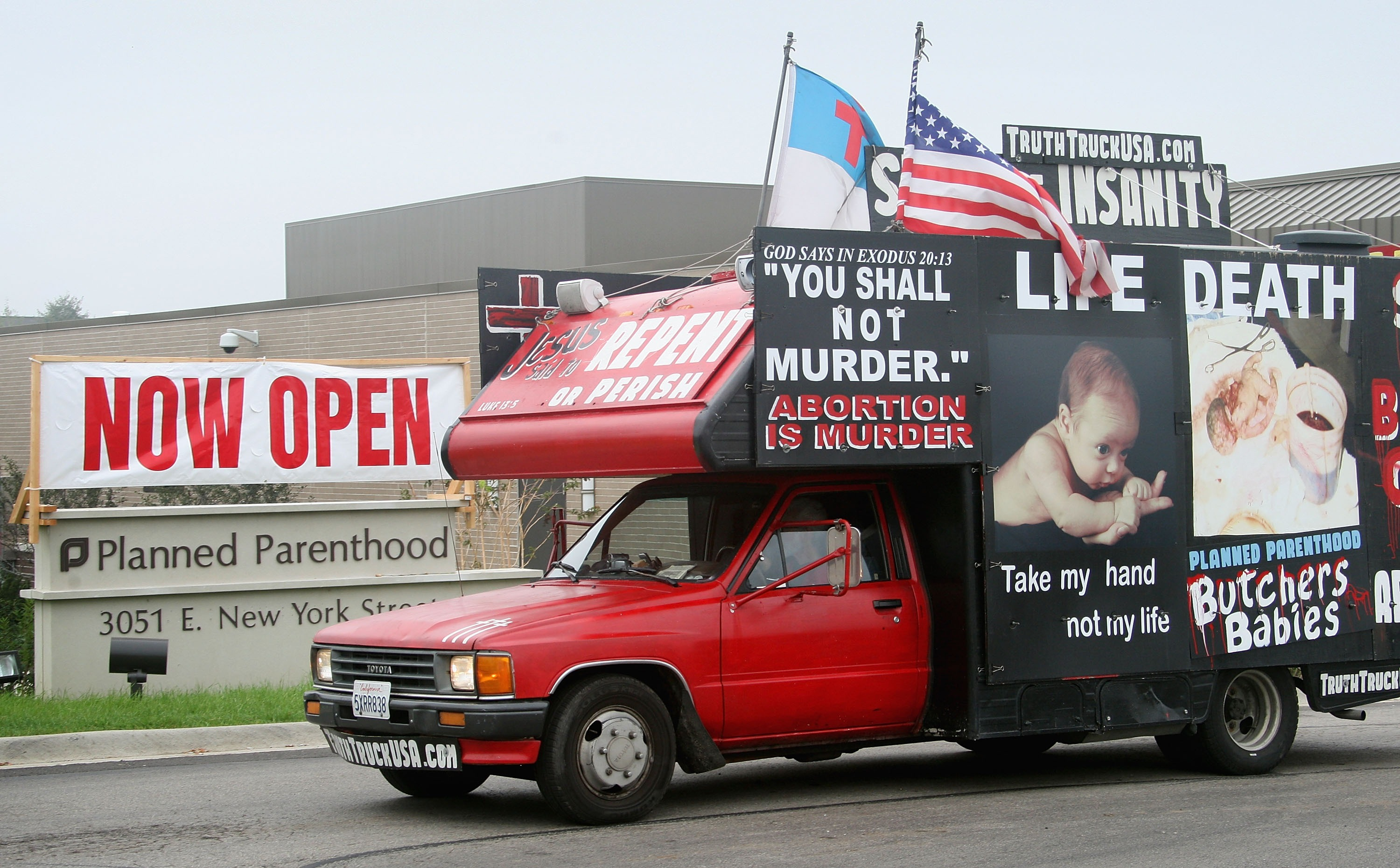 A truck covered with anti-abortion messages is used to protest the opening of a Planned Parenthood clinic in Aurora, Illinois on Oct. 2, 2007.