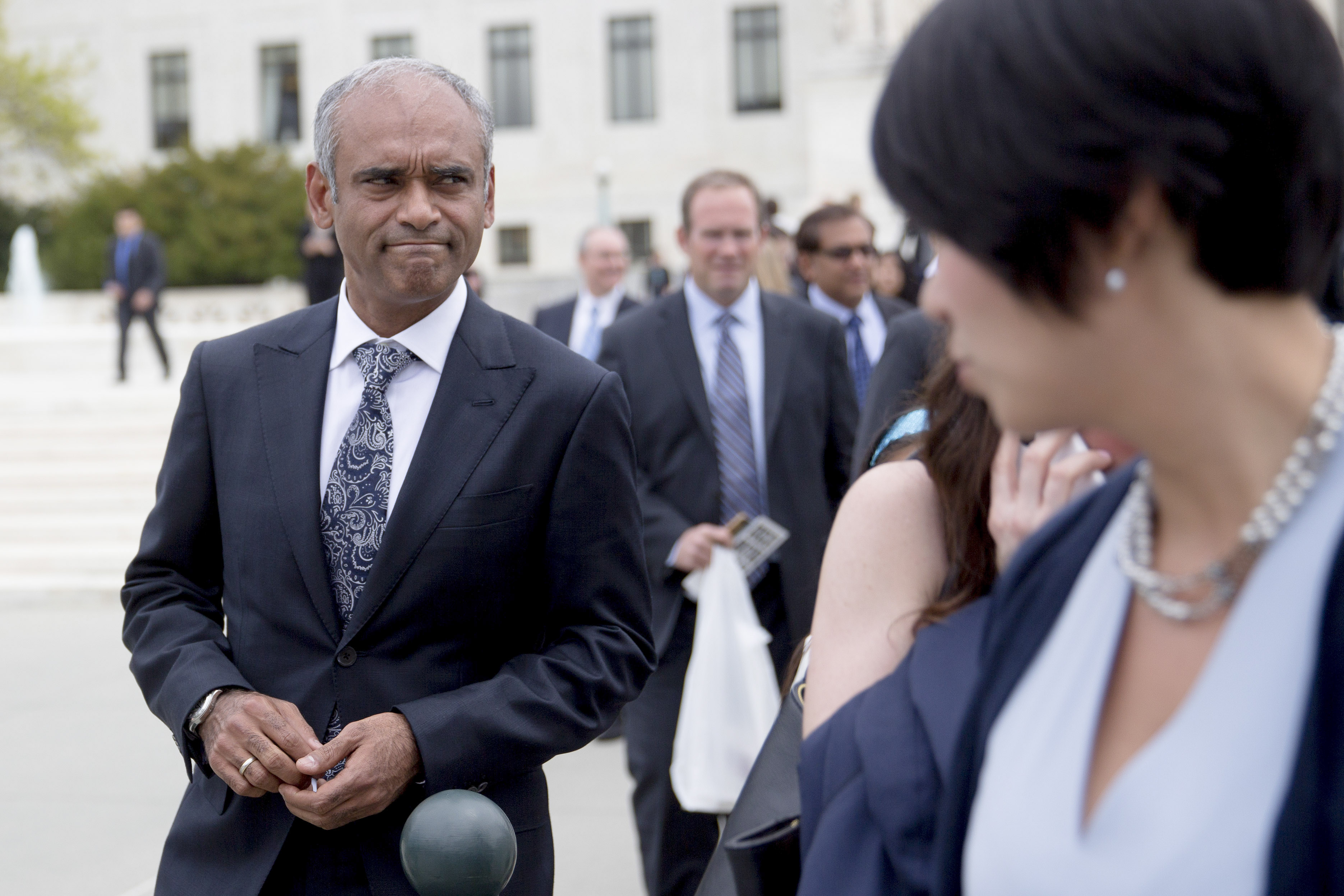 Chet Kanojia, chief executive officer of Aereo Inc., left, leaves the U.S. Supreme Court following oral arguments by Aereo Inc. and American Broadcasting Companies Inc. in Washington, D.C., U.S., on Tuesday, April 22, 2014.