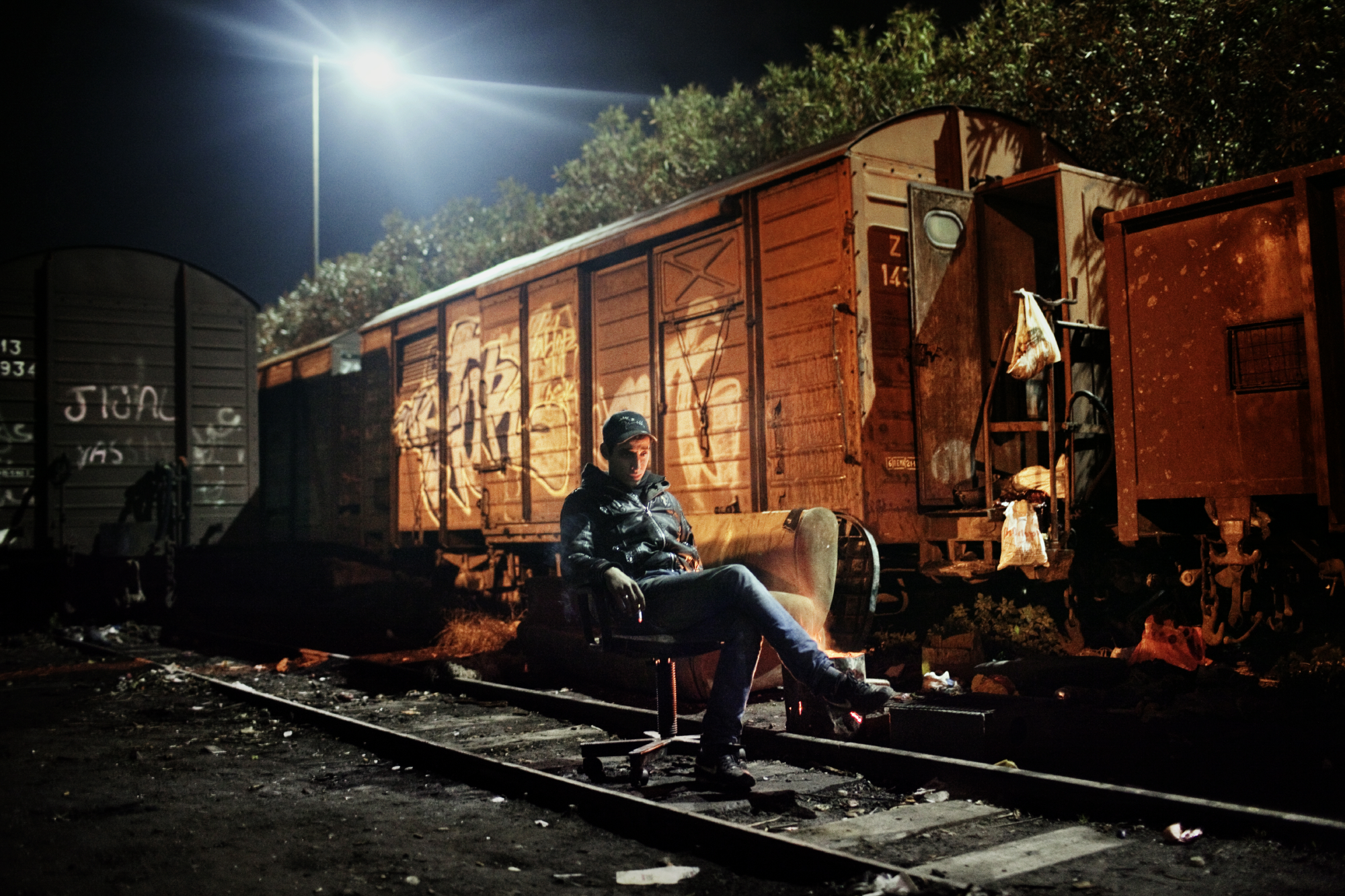 17-year old Ali from Algeria lives in the old train station of Corinth, Greece. He hopes to be able to board a boat to Western Europe.