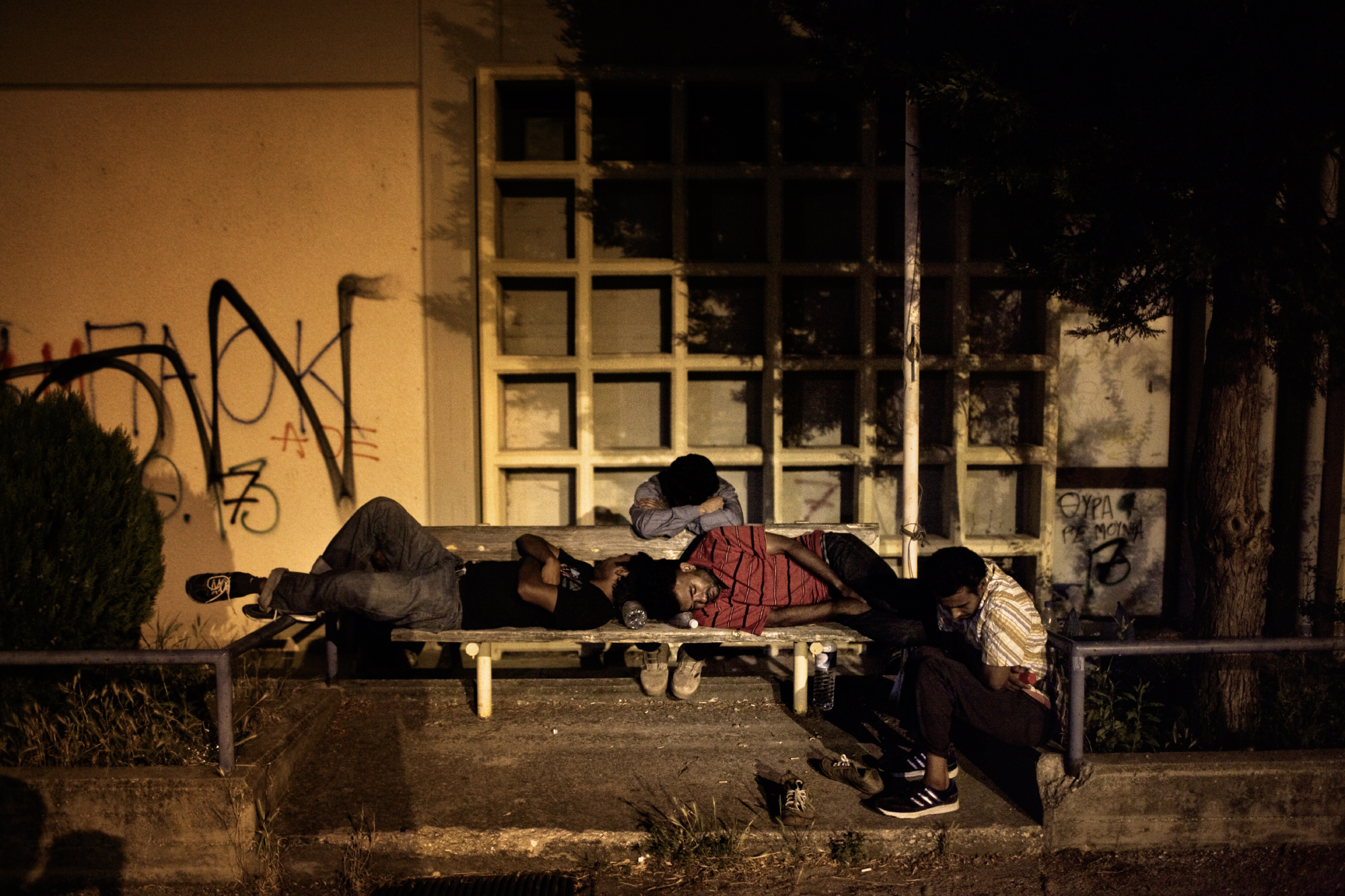 A group of migrants spends the night in the railway station of Orestiada, Greece, after crossing the border with Turkey.