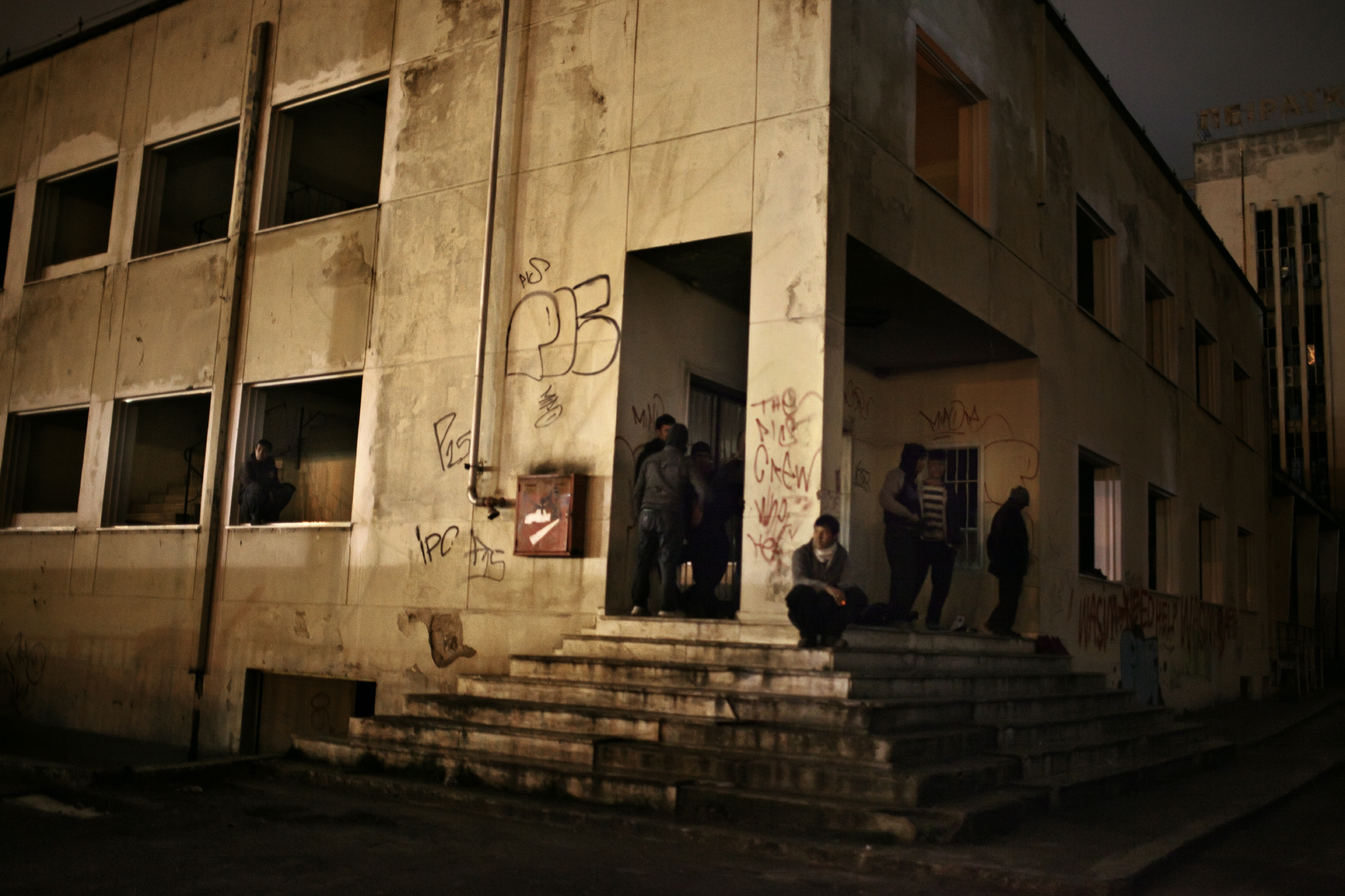 A group of Afghans in abandoned factory in Patras, Greece – one of the main escape points from Greece due to the numerous cargo ships that dock in the port and are bound for Italy.