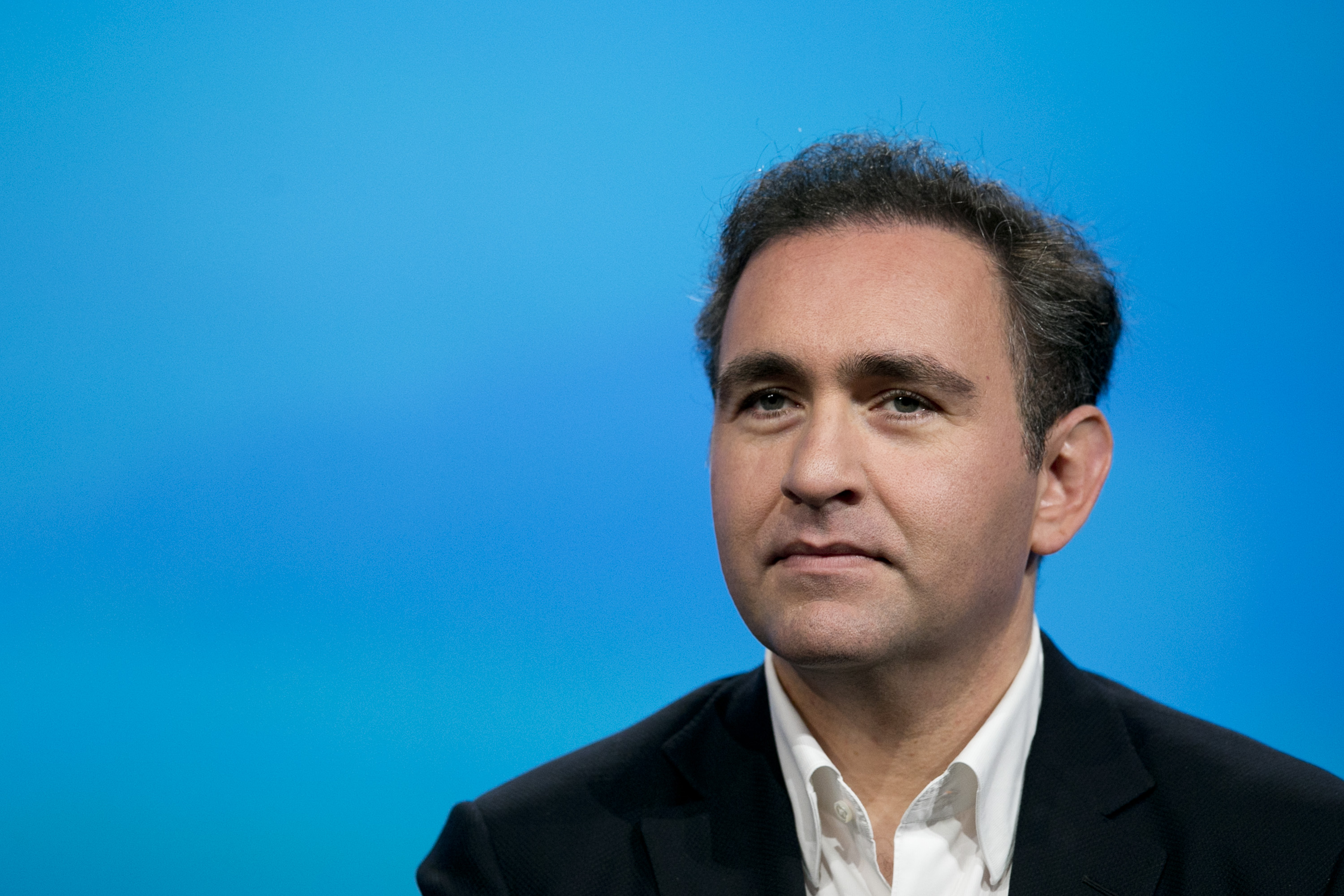 Ali Rowghani, chief operating officer of Twitter Inc., listens during a panel discussion at the National Cable and Telecommunications Association Cable Show in Washington on June 10, 2013.