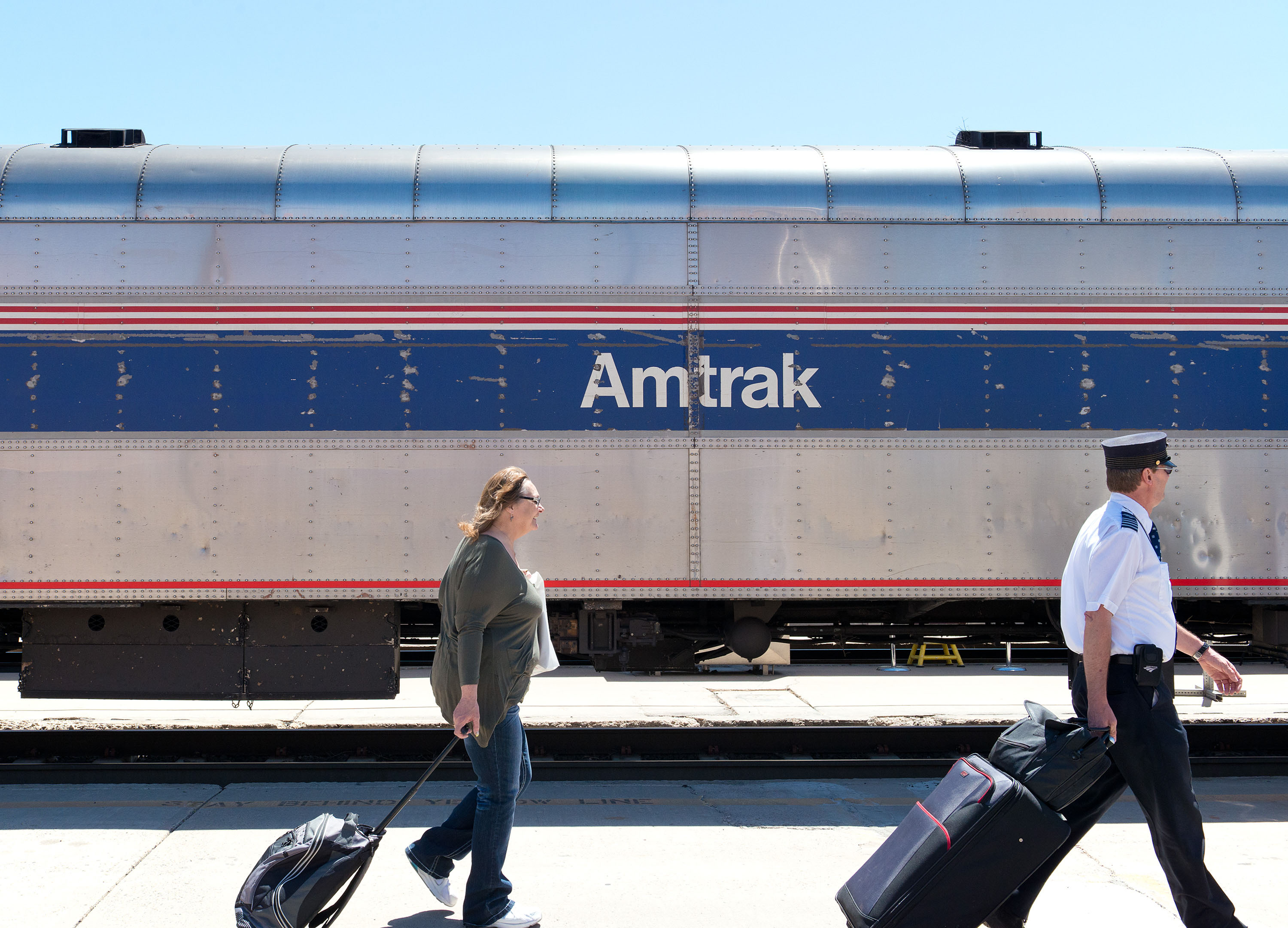 Arriving Amtrak passengers are seen walking towards the terminal during Amtrak's National Train Day on May 10, 2014 in Albuquerque, N.M.