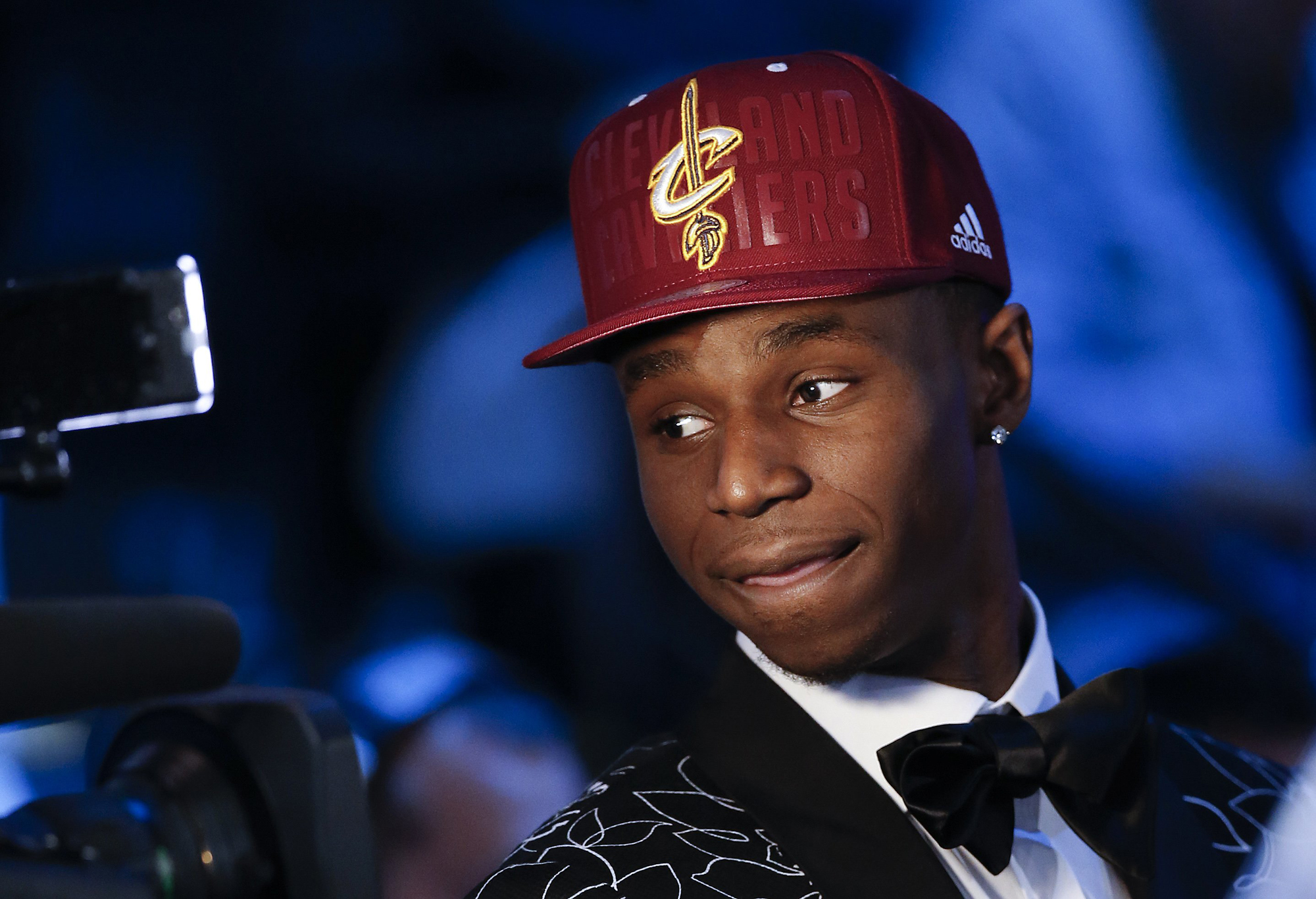 Andrew Wiggins of Kansas stops for a television interview after being selected by the Cleveland Cavaliers as the number one pick in the 2014 NBA draft, June 26, in New York.