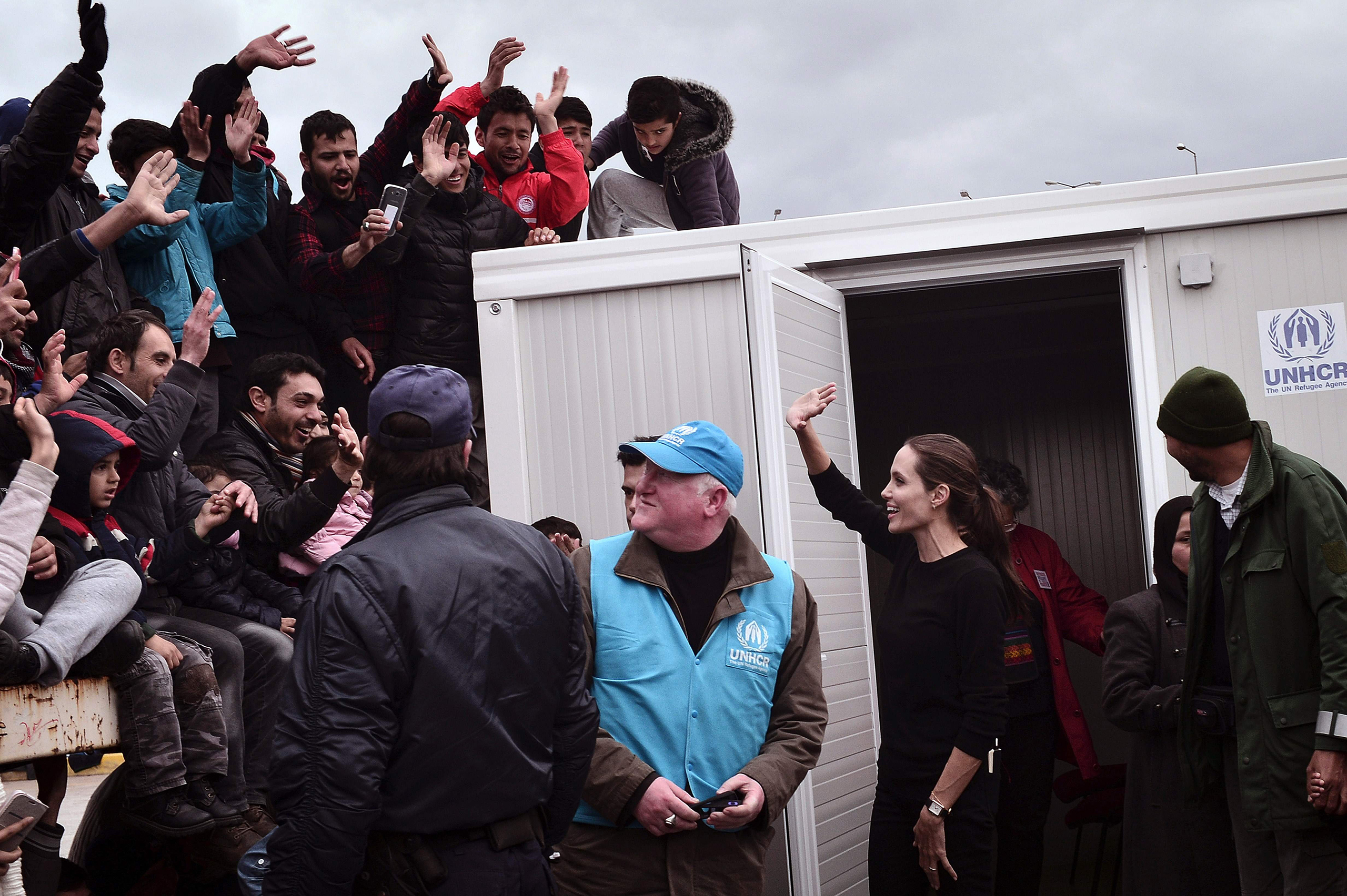 UNHCR's Goodwill Ambassador Angelina Jolie Pitt greets refugees and migrants during her visit to the port of Piraeus, Greece, March 16, 2016. She urged 