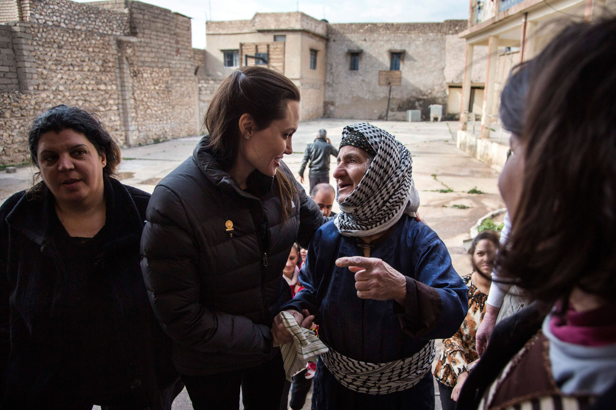 "United Nations High Commissioner for Refugees (UNHCR) Special Envoy Angelina Jolie meets displaced Iraqis who are members of the minority Christian community, living in an abandoned school in Al Qosh, northern Iraq on Jan. 26, 2015.  Jolie wrote <a href=""http://www.nytimes.com/2015/01/28/opinion/angelina-jolie-on-the-syrians-and-iraqis-who-cant-go-home.html?_r=1"">an Op-Ed</a> for the New York <i>Times</i> on the suffering she witnessed there."