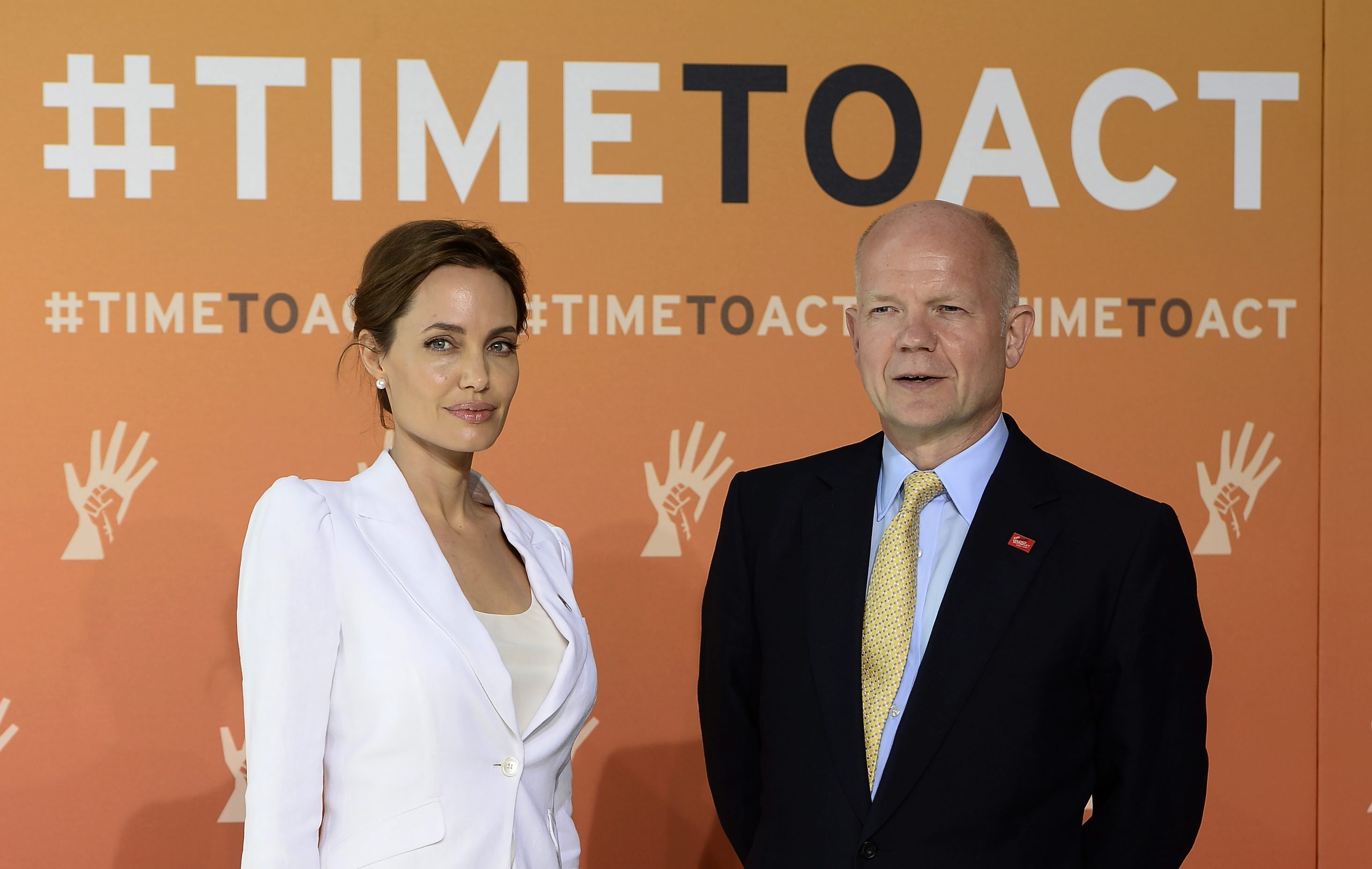 From left: Angelina Jolie and Britain's Foreign Secretary William Hague arrive at the Global Summit to End Sexual Violence in Conflict at the Excel Centre in London on June 10, 2014.