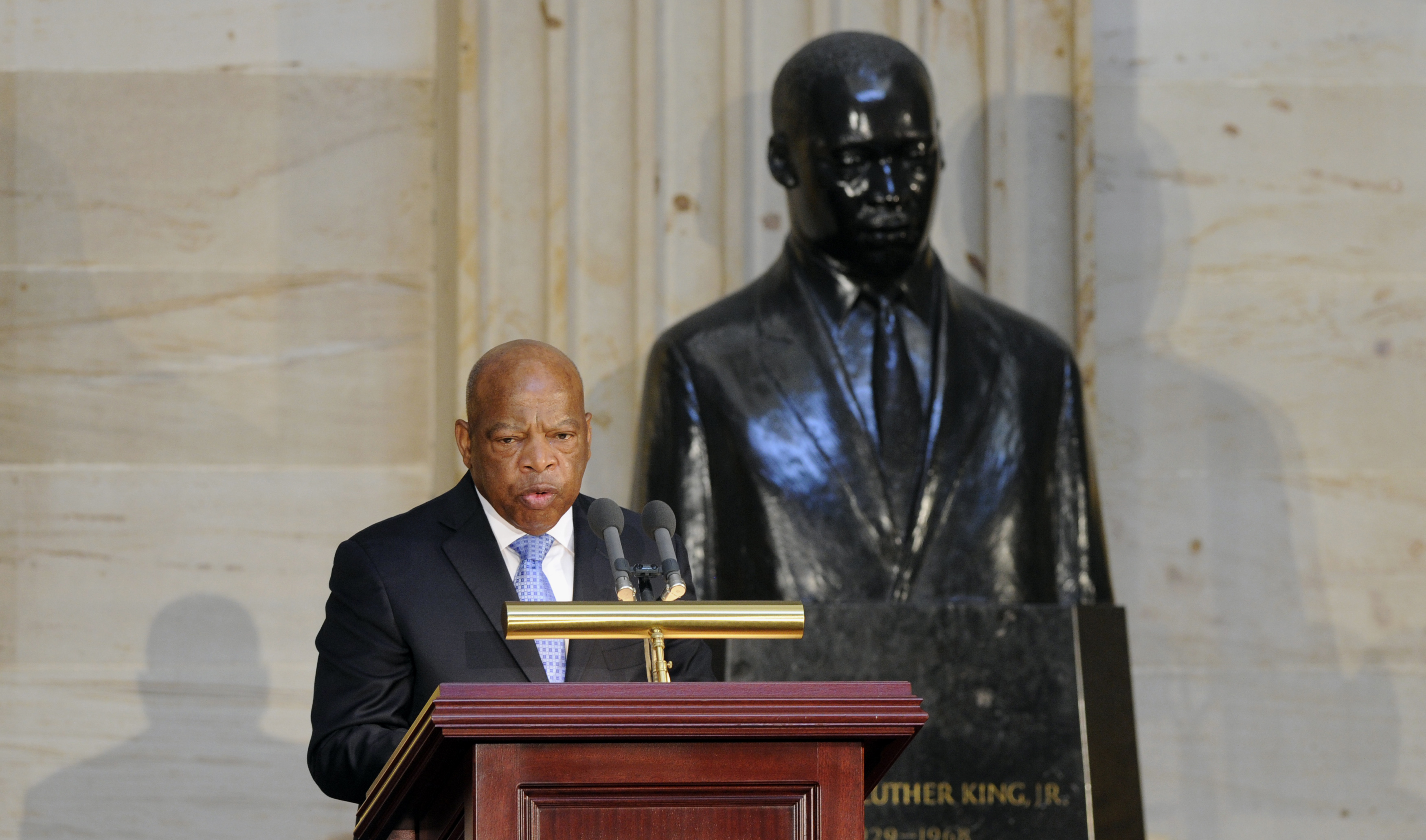 Democratic Representative John Lewis of Georgia stands in front of a statue of Martin Luther King Jr. as he speaks during the 50th anniversary ceremony for the Civil Rights Act of 1964 on Capitol Hill, in Washington, D.C., on June 24, 2014