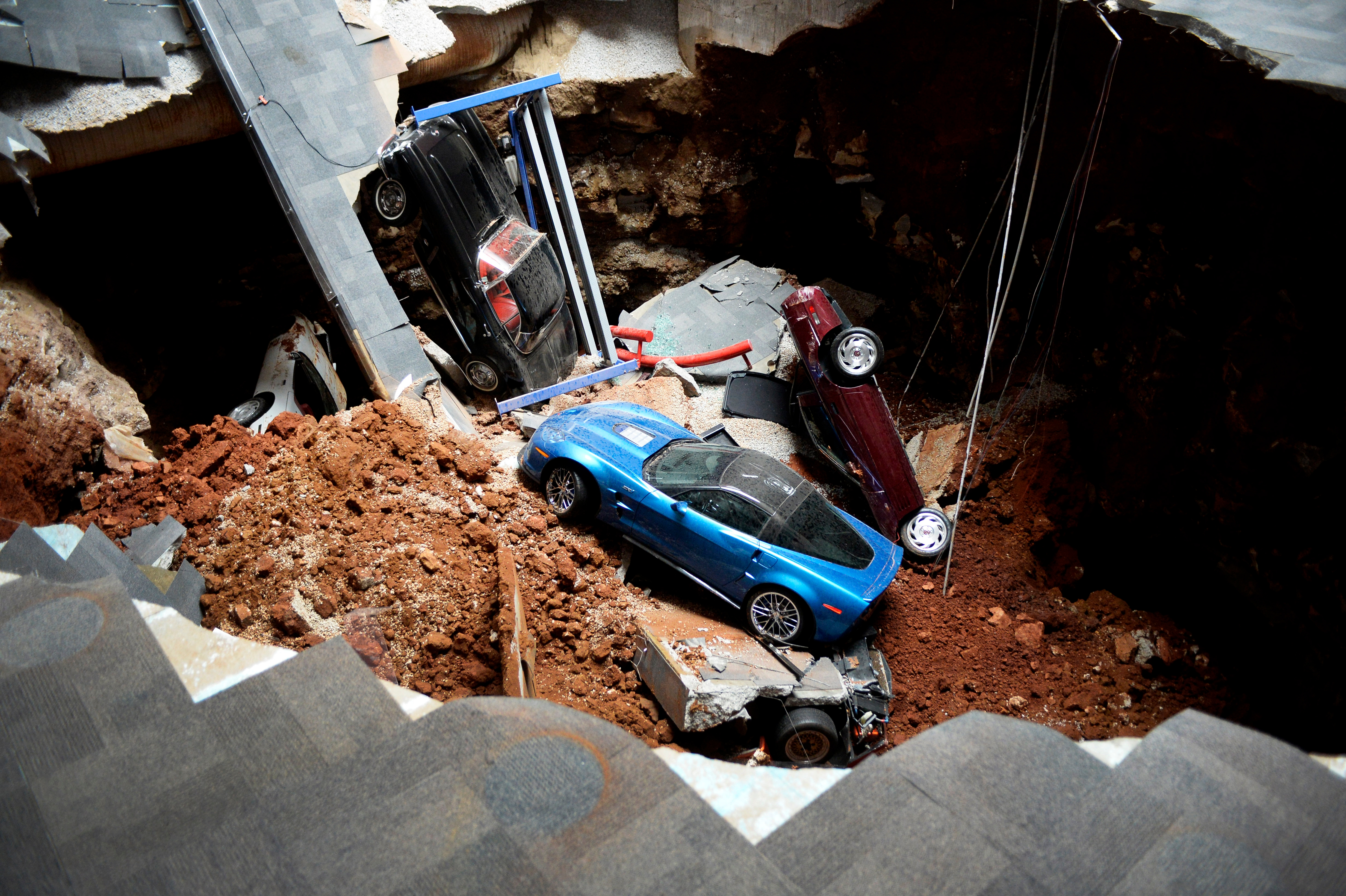 A view of a sinkhole that opened up in the Skydome showroom, Wednesday, Feb. 12, 2014, at the National Corvette Museum in Bowling Green, Ky.