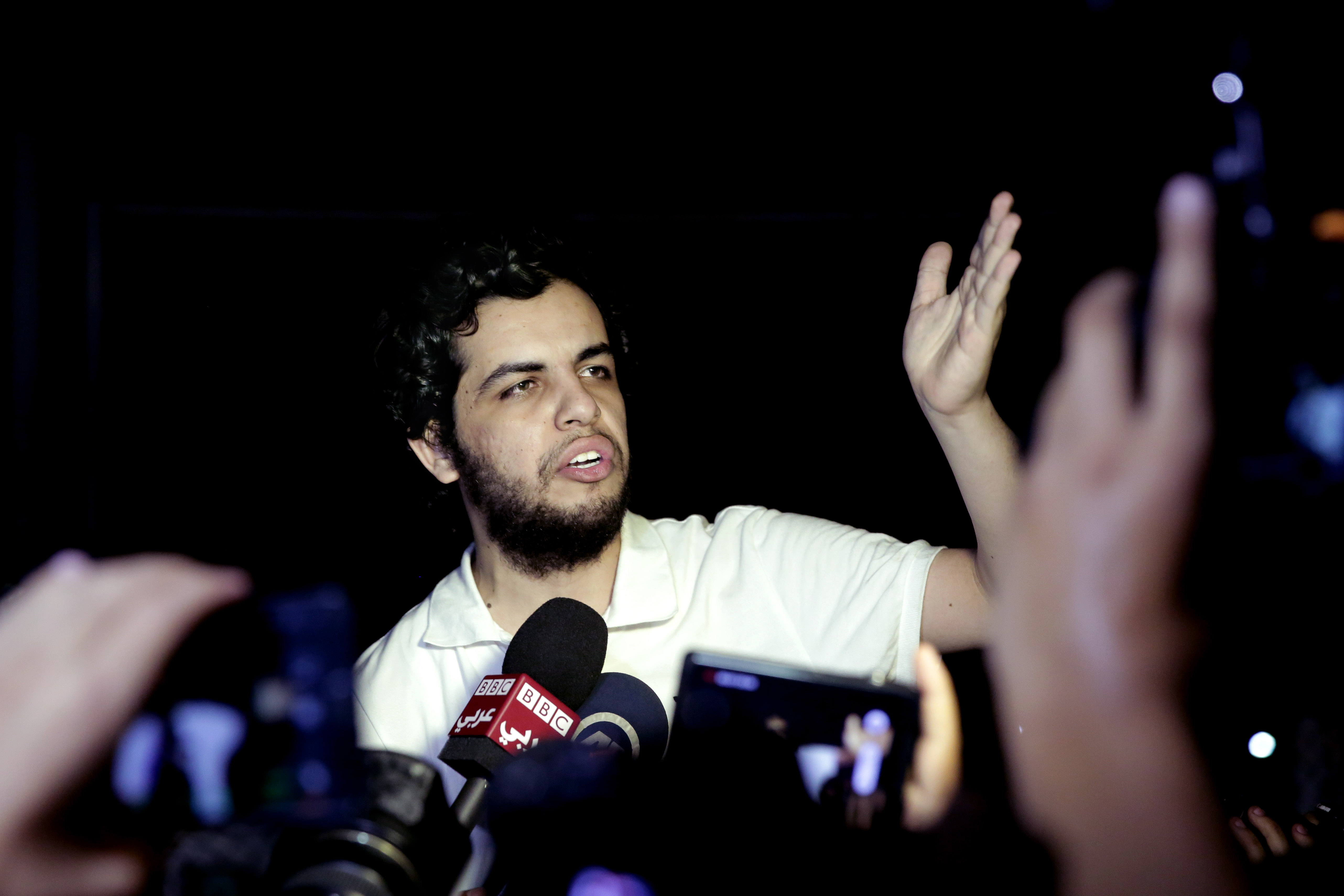 Al-Jazeera Arabic service journalist Abdullah Elshamy, who had been on hunger strike for more than four months to protest his prolonged detention without charges, speaks to the media after his release from detention in Cairo on Tuesday, June 17, 2014.