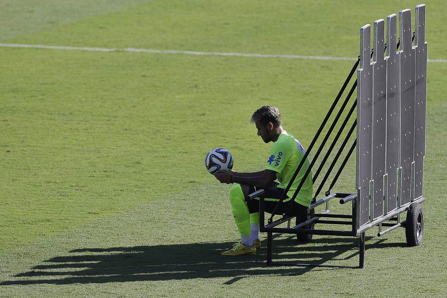 June 27, 2014. Brazil's Neymar sits behind a training barrier during a practice session one day before his team's round of 16 World Cup soccer match with Chile at Mineirao Stadium in Belo Horizonte, Brazil.