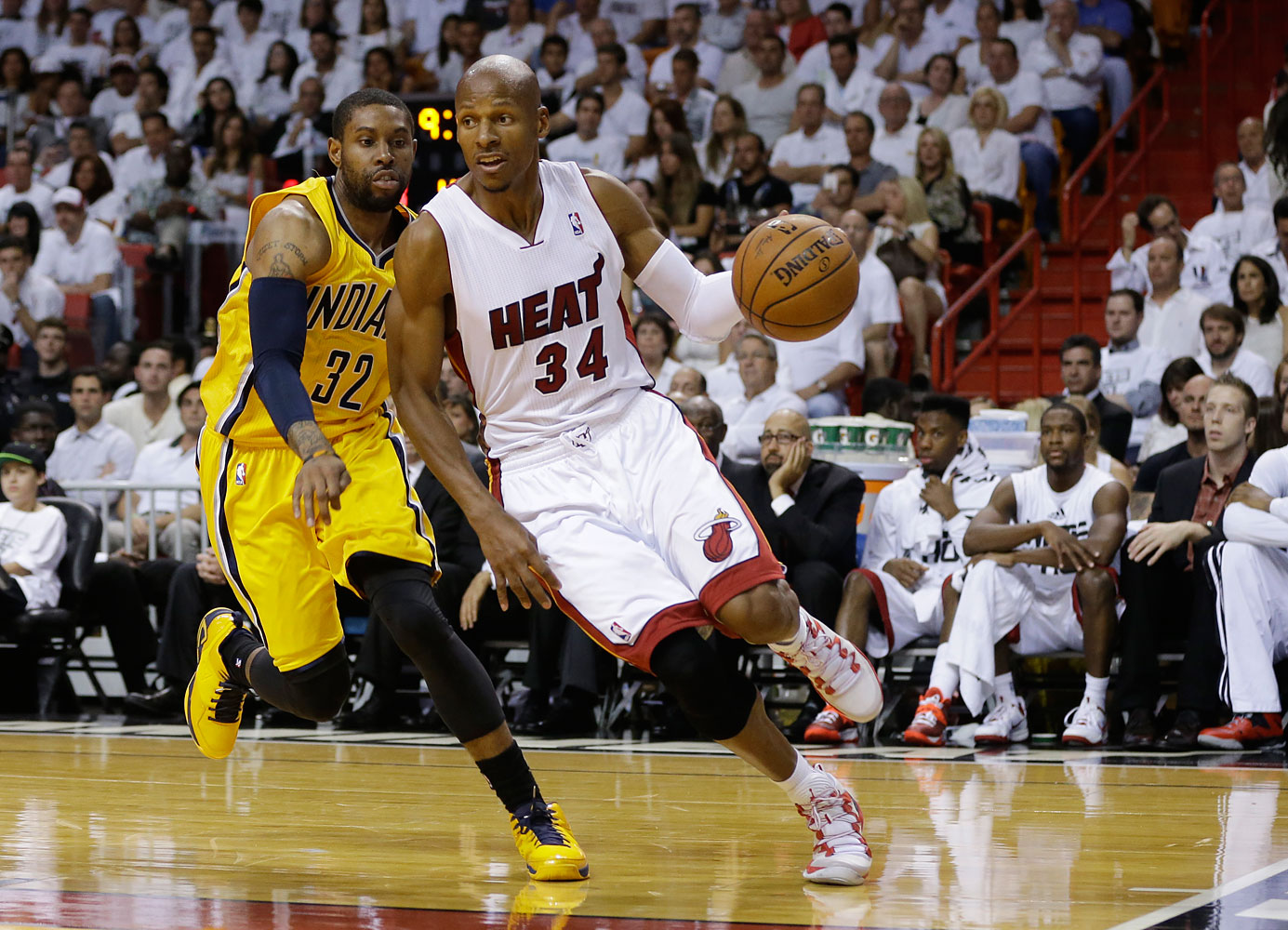 Miami Heat guard Ray Allen, 34, drives to the basket as Indiana Pacers guard C.J. Watson, 32, defends, during the second half Game 6 in the NBA basketball playoffs Eastern Conference finals, May 30, 2014, in Miami.